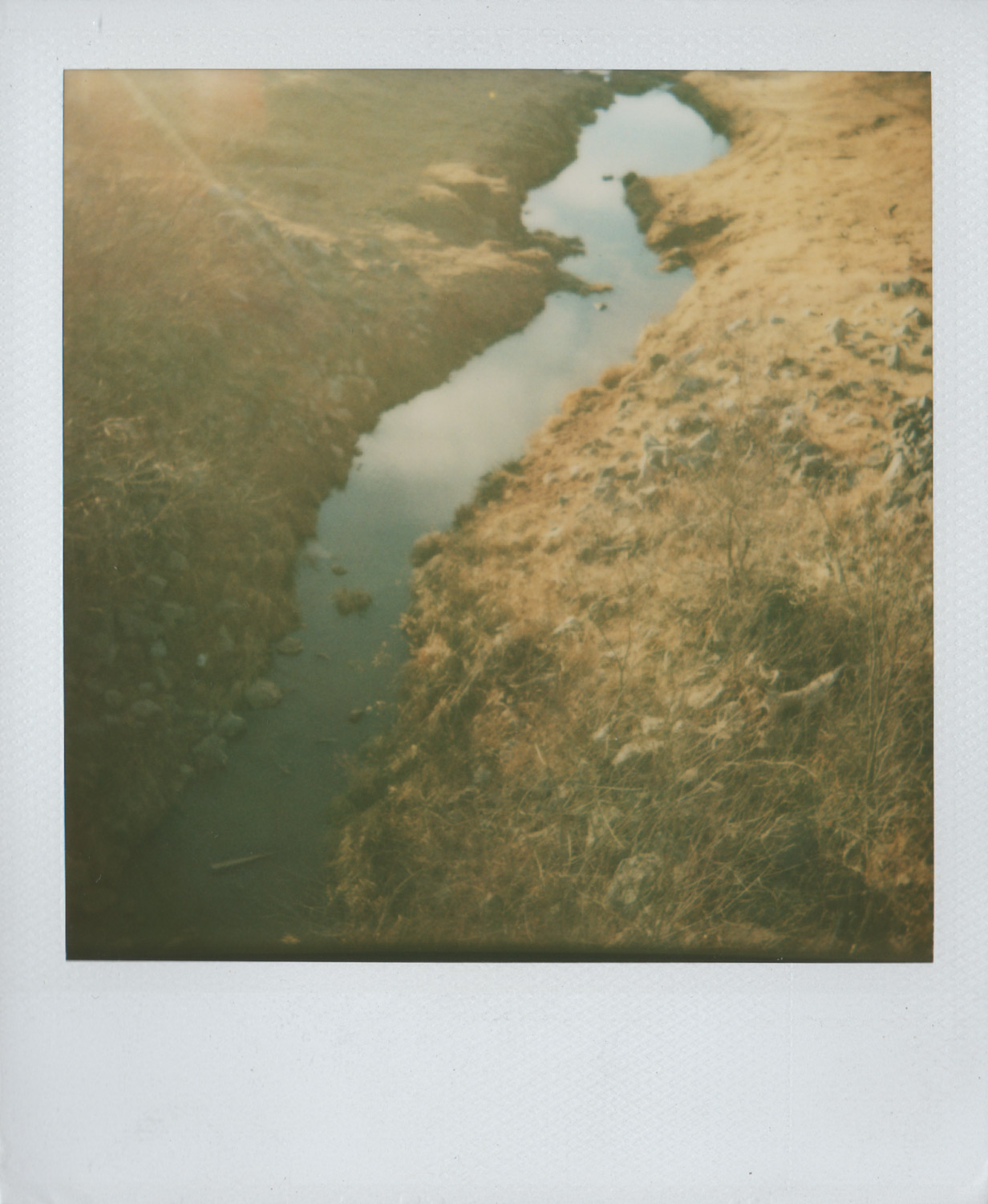 Clouds in the creek and my lover's gone