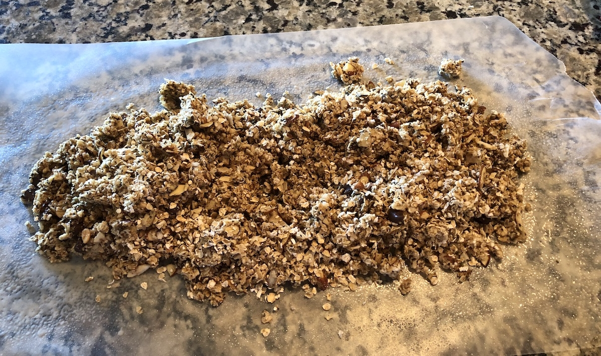 Spread the granola out on Wax Paper, and then roll it out.
