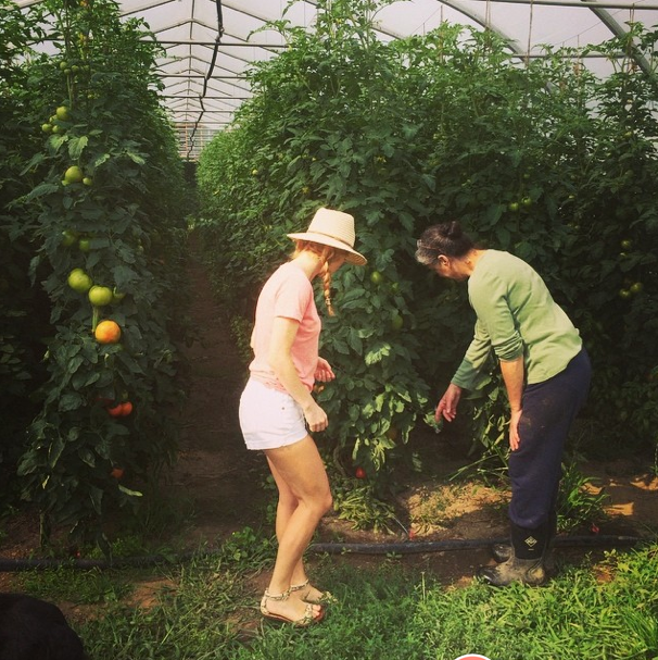 Justine and Jessica checking out tomatoes.
