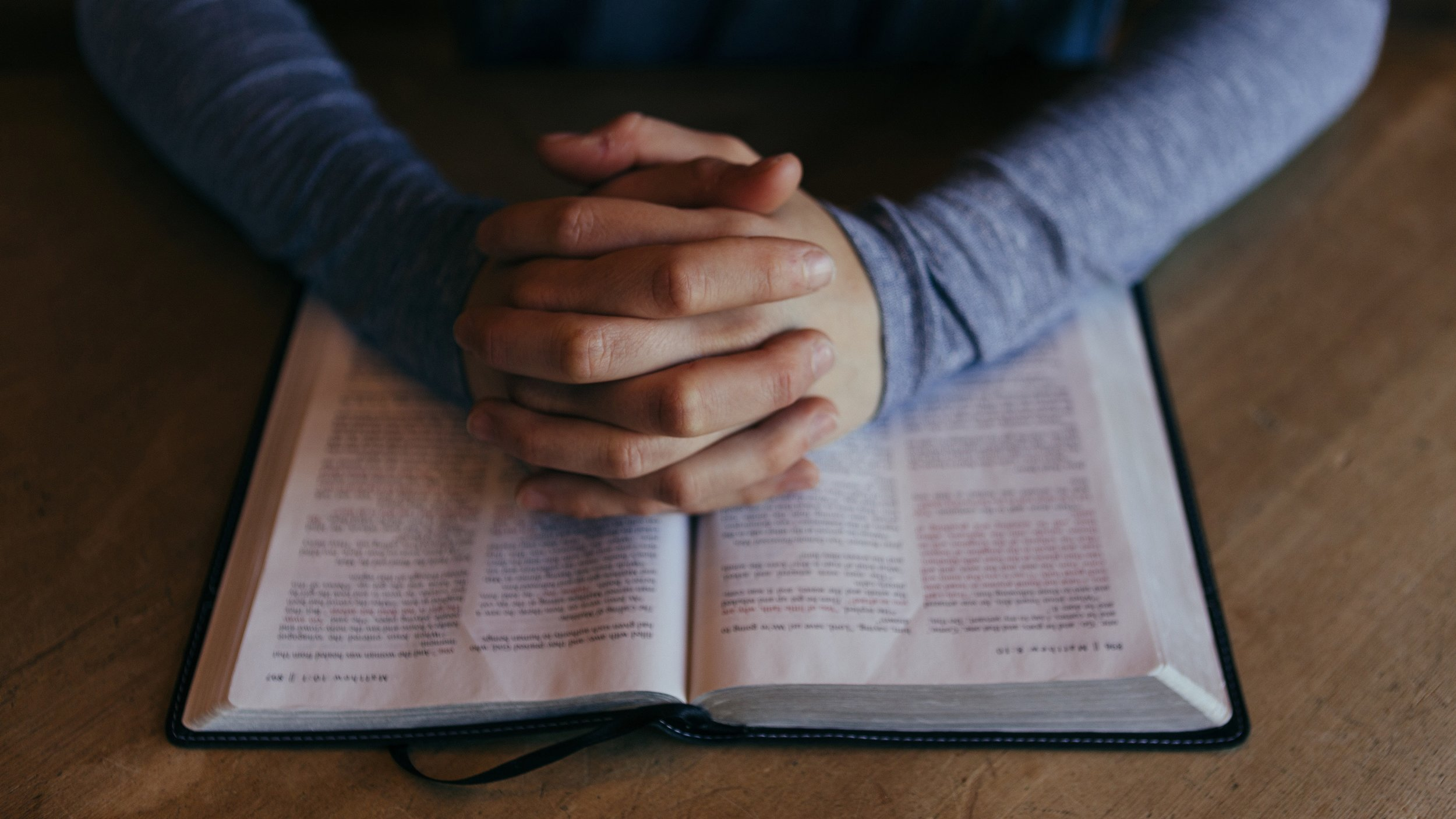 Praying Hands Bible Religious Stock Photo.jpg