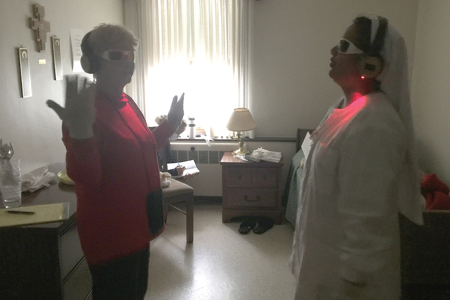 Kate Guay, assistant administrator, and Sister Beena Jose, a nurse in Antonia Hall, take part in the Virtual Dementia Tour.