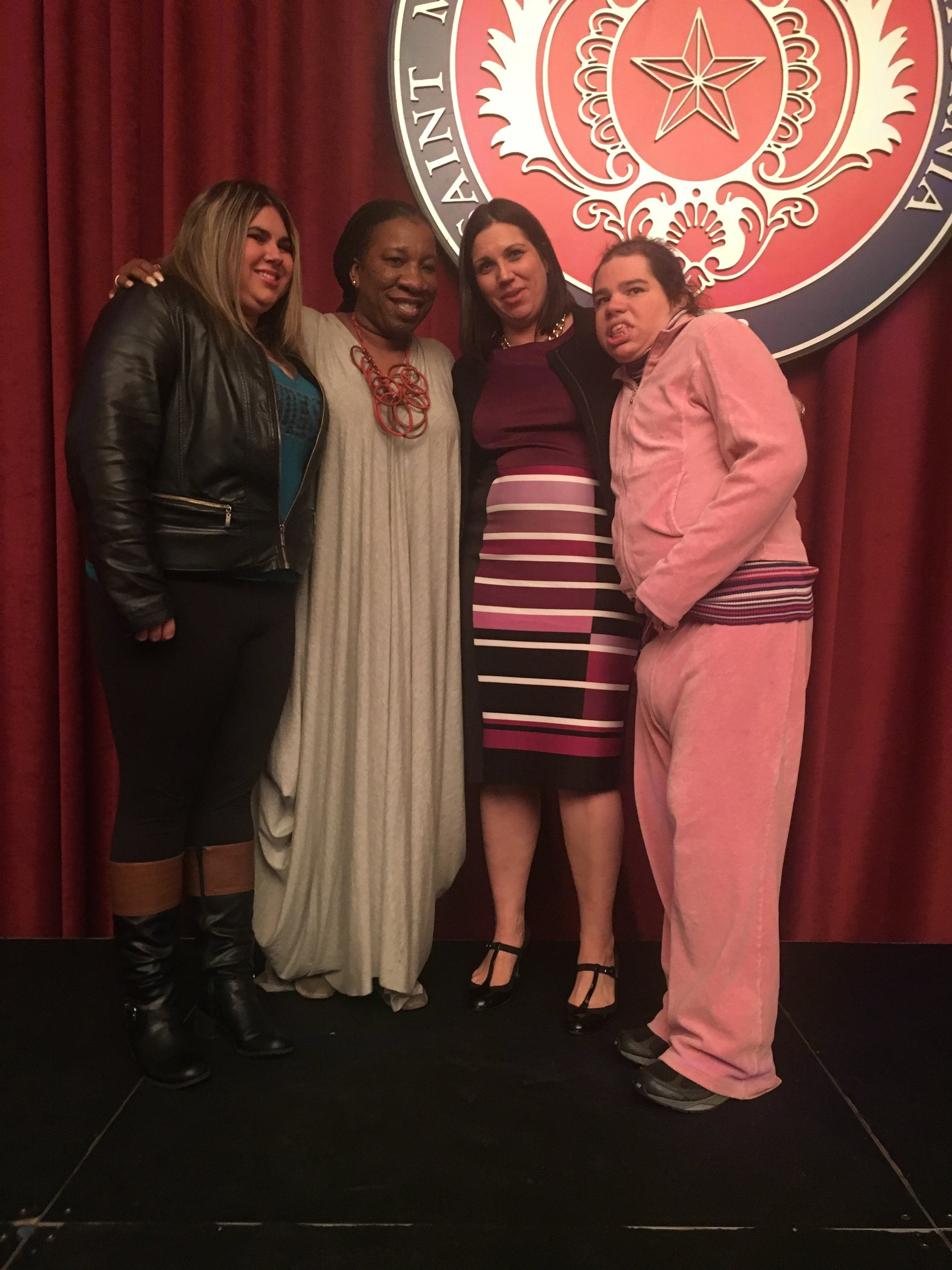 Neward with Tarana Burke, founder of the #MeToo movement, and her sisters Patricia (left) and Natalie (right).