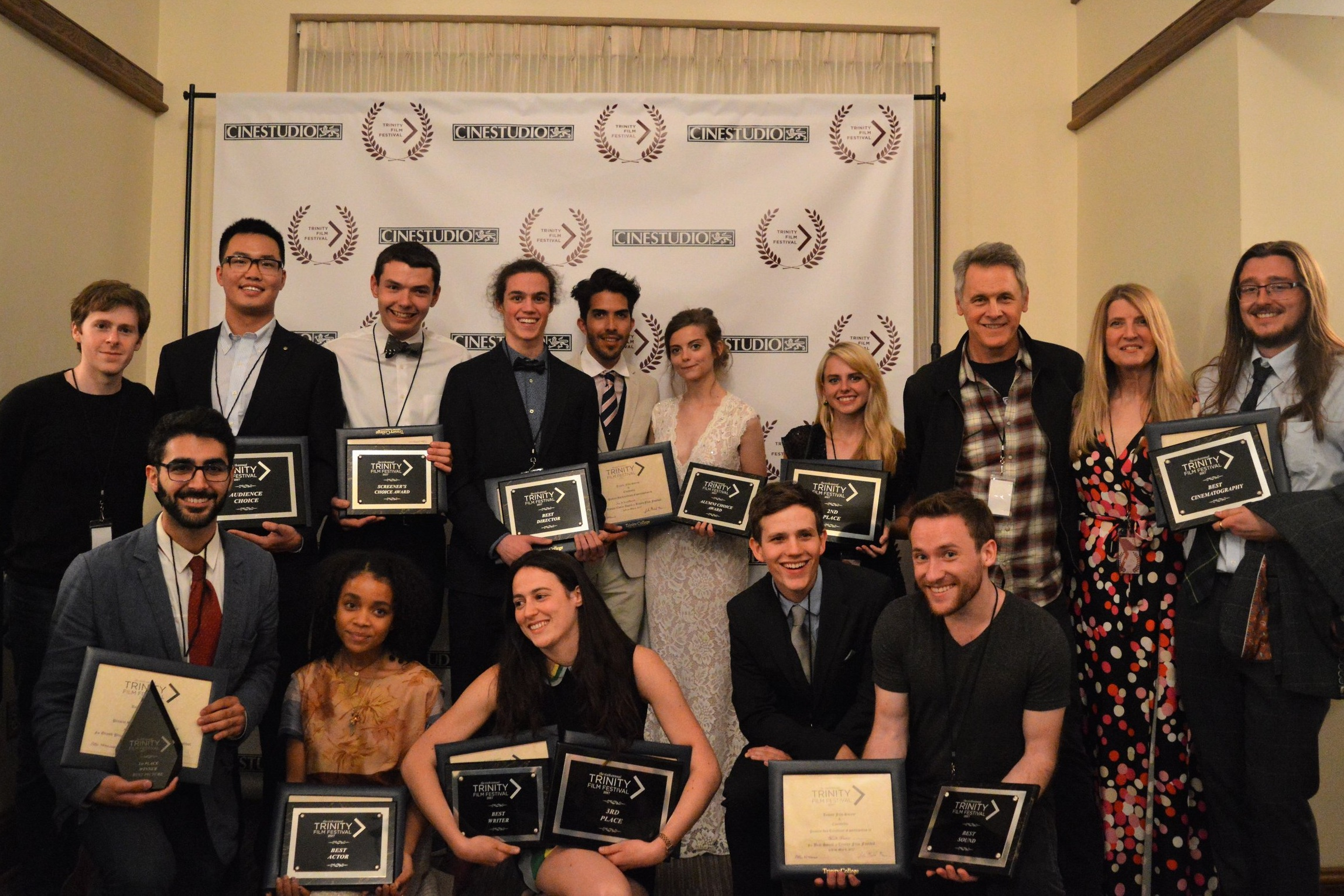 The 2017 winning filmmakers pose with guest judges Pierce Cravens, Kimberly Skyrme, and Mark Moses.