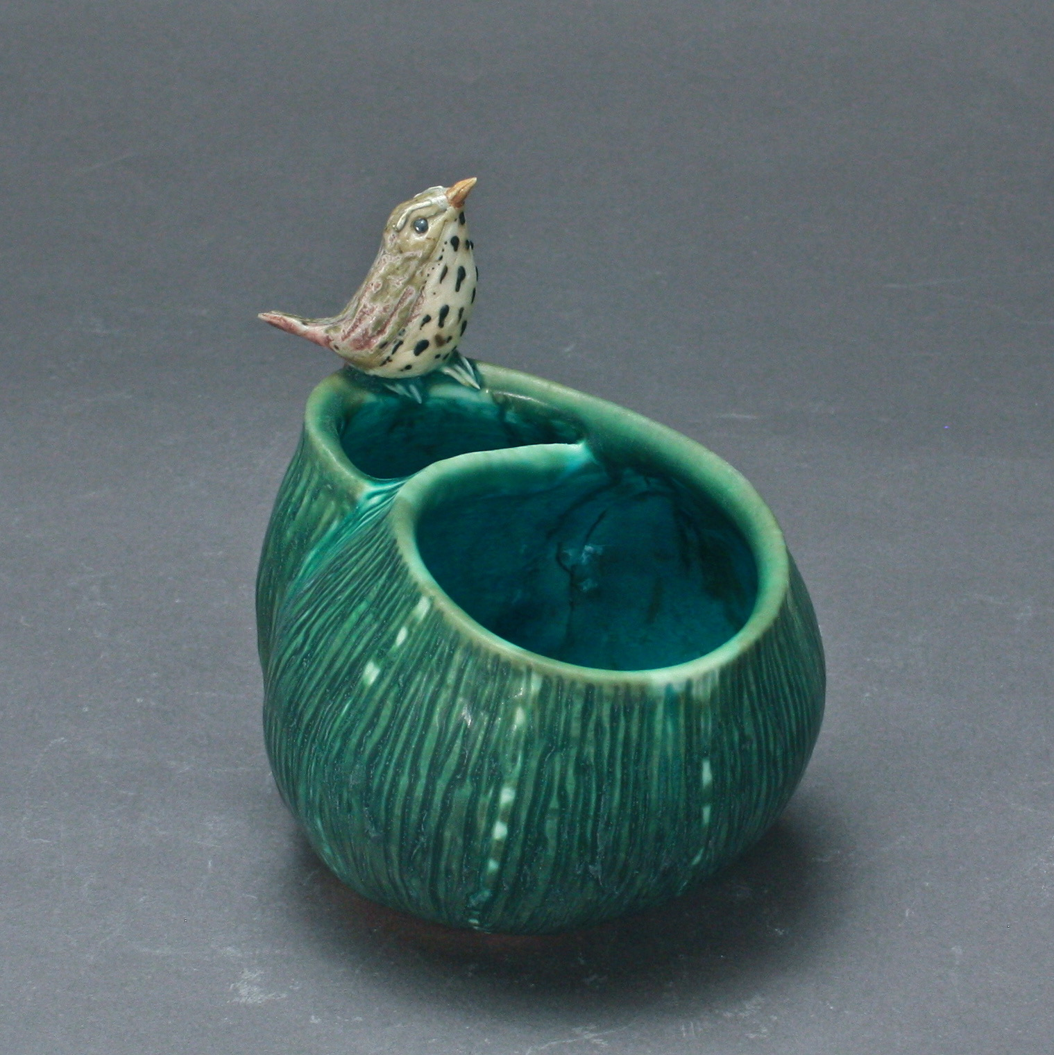 P-24 | Small Dark Green Folded Pool with Thrush ($150)