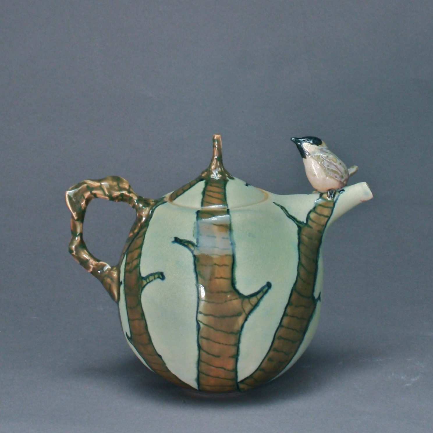 T-26 |  | Winter Tree Celadon Teapot with Chickadee ($295)
