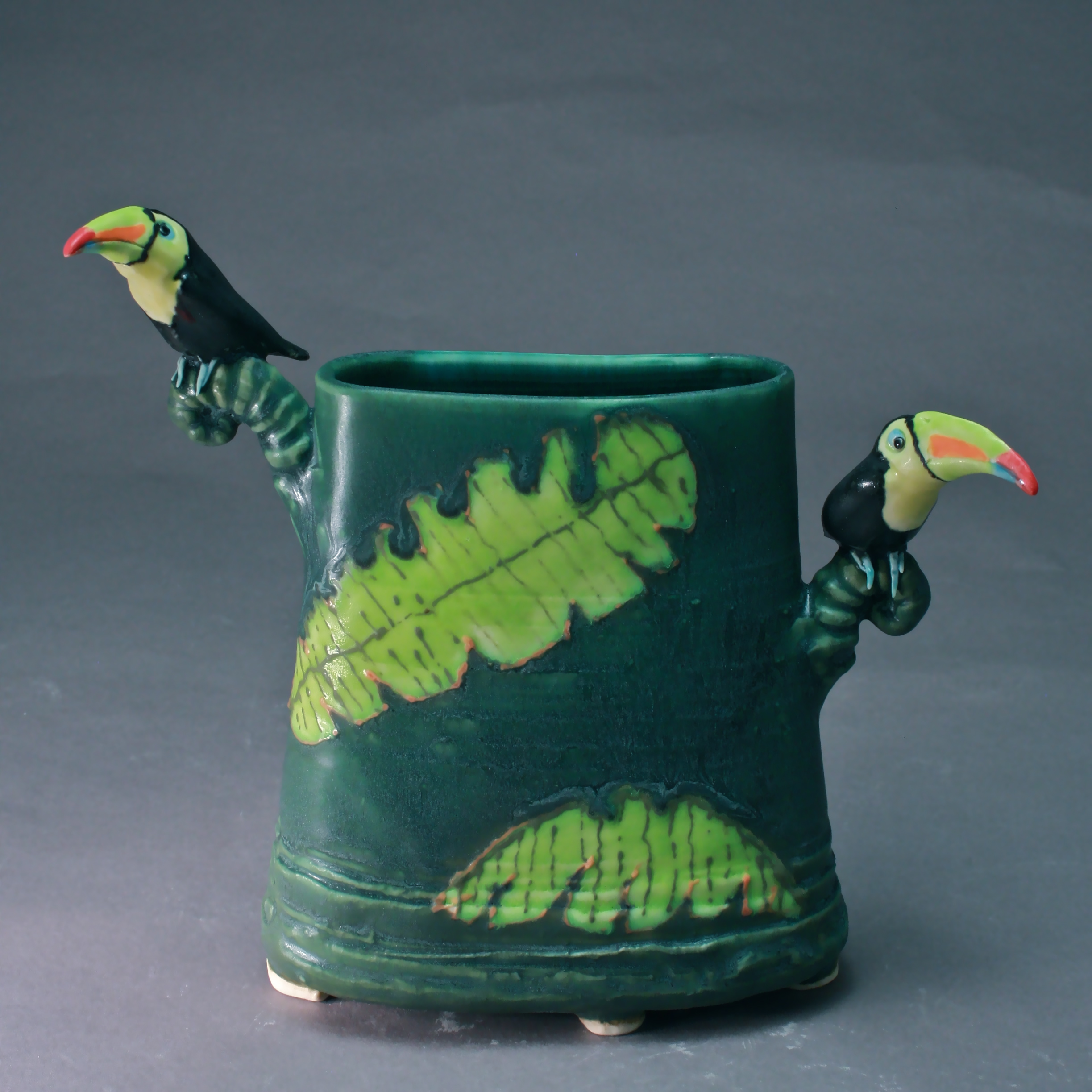 V-27 | Banana Leaf Dark Green Envelope Vase with Toucans ($250)