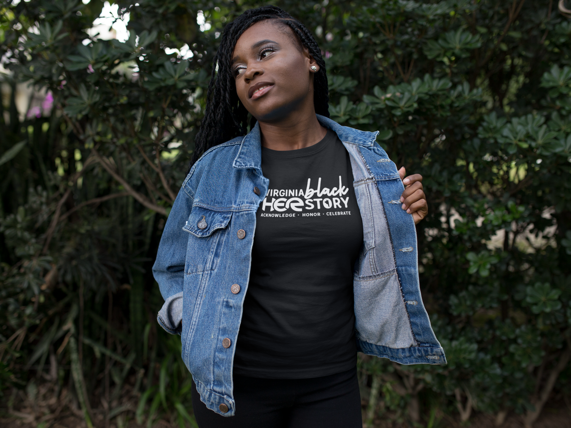black-girl-wearing-a-round-neck-tee-template-while-standing-against-plants-a17189.png