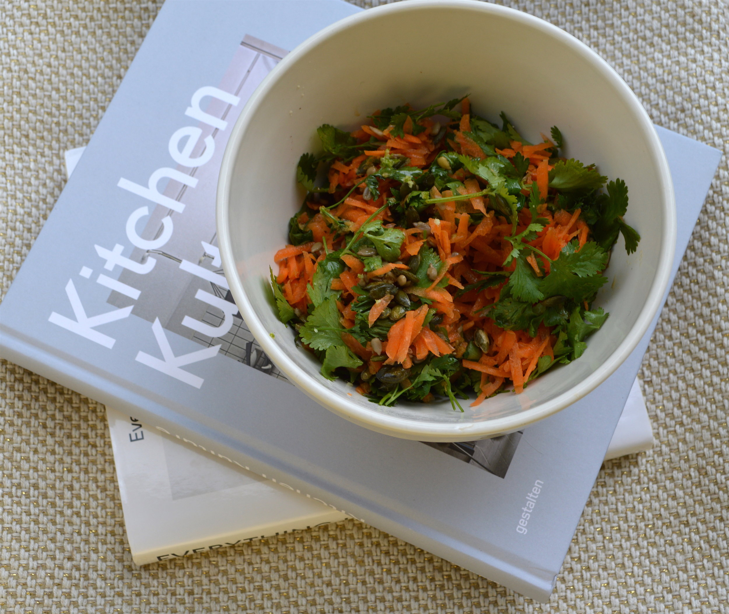 This is a good one to take into work as it doesn't go soggy or makes for a nice side.  It's great with roast chicken or a fillet of fish!  Below are two great book recommendations; Kitchen Kulture from Gestalten which has some incredible kitchen interiors and Everything I Want To Eat by Jessica Koslow.  Serves 1  Ingredients:  4 carrots, grated  3 tbsp toasted pumpkin seeds  2 tbsp sunflower seeds  large handful coriander leaves  large handful parsley leaves  Dressing:  1 large tsp grated ginger  1 tbsp soya sauce  2 tbsp sunflower seeds  2 tbsp cidre vinegar/white wine vinegar  3 tbsp olive oil  1 tbsp lime juice  sea salt and black pepper  In a bowl add all the ingredients and mix the dressing ingredients separately in a small bowl.  Taste to check the seasoning and toss through the salad.  Eat straight away.