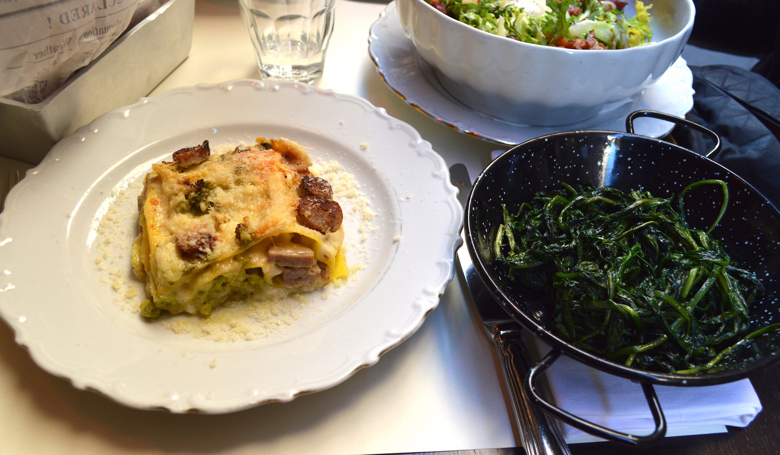 La Buvette  La Buvette is located just two minutes from The Spanish steps so you can do some tourist sightseeing before heading there for lunch or dinner.  It has a laid-back French bistro style with leather banquet seating and you can sit outside when the weather is good.  I loved the fact that they offered a lasagna of the day which was broccoli, sausage and mozzarella.  Great for lunchtime salads.  Via Vittoria, 44, 00187 Roma, Italy  +39 06 679 0383