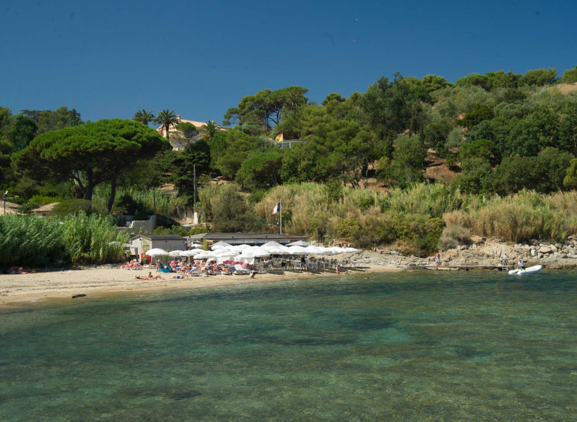 Les Graniers  One of the most beautiful and secluded beaches situated right behind the St Tropez citadel. You can access the little beach by boat or on foot and enjoy a sunny lunch on the beach. This is one that I mentioned in my St Tropez book many times and since the book it has changed hands and has a Spanish fusion running through the food. The cuisine is actually better than before so you must check it out for a dreamy lunch!  Plage des Graniers Saint-Tropez 04 94 97 38 50   http://www.plagedesgraniers.com