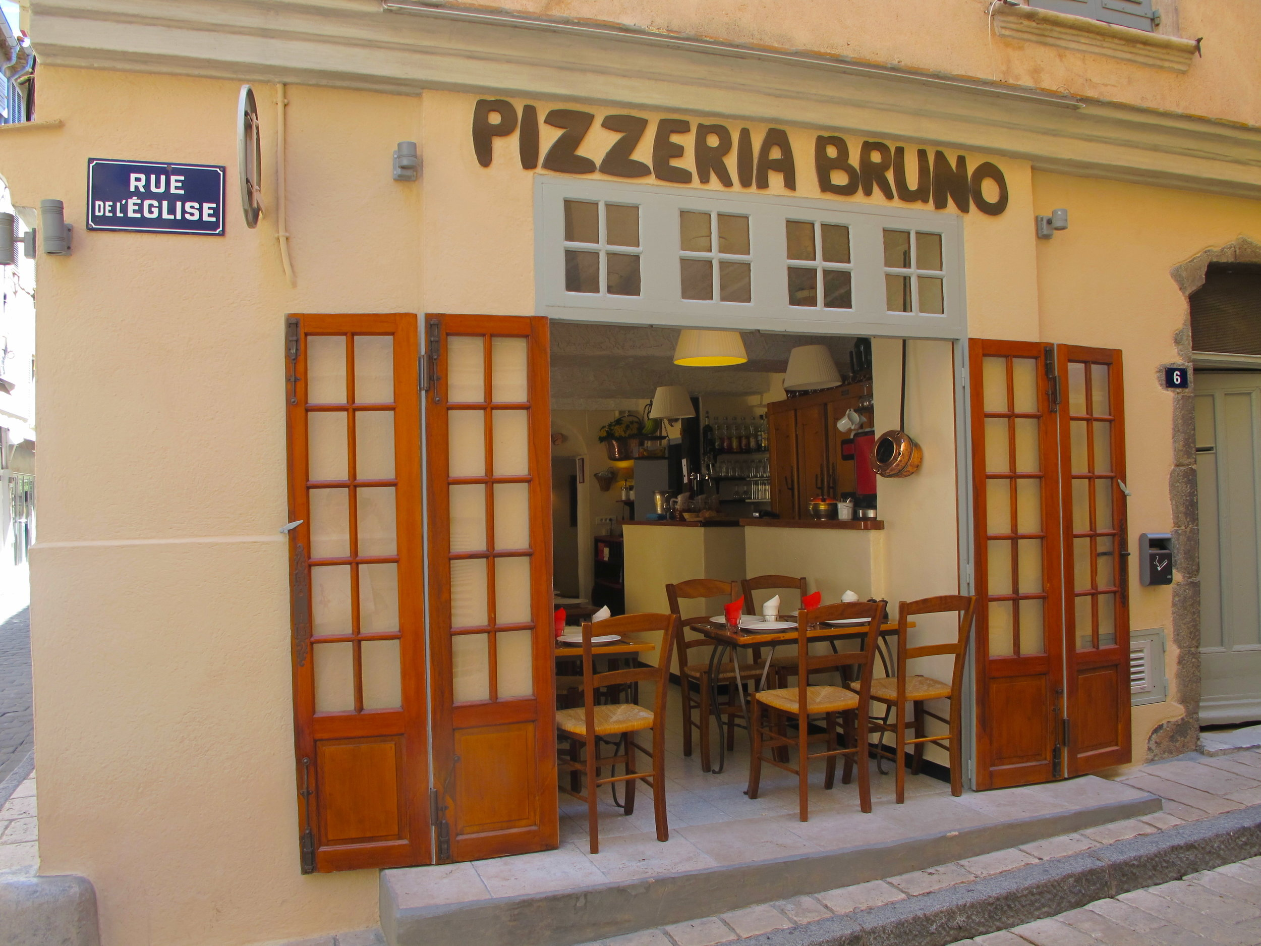 Bruno  Brigitte Bardot used to come here and it has been going since the 50s so they must be doing something right. The pizza are good value and the atmosphere is always buzzing. Wood fired oven pizza that is smokey and delicious.  6 Rue de l'Église, 83990 Saint-Tropez, France Tel: +33 4 94 97 05 18  https://www.tripadvisor.co.uk/Restaurant_Review-g187242-d2197179-Reviews-Pizzeria_Bruno-Saint_Tropez_French_Riviera_Cote_d_Azur_Provence.html