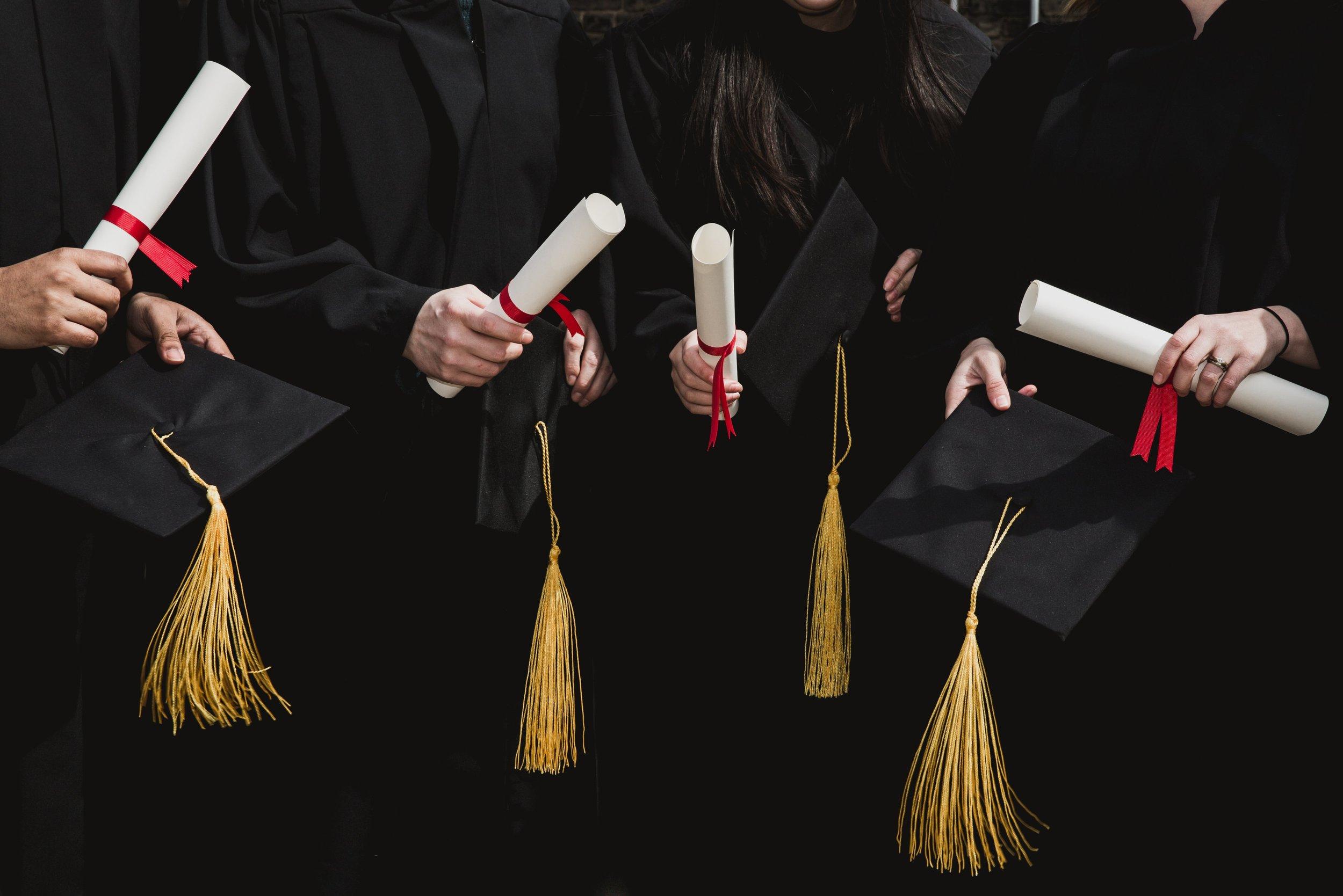 four-grad-students-caps-and-diplomas_4460x4460.jpg