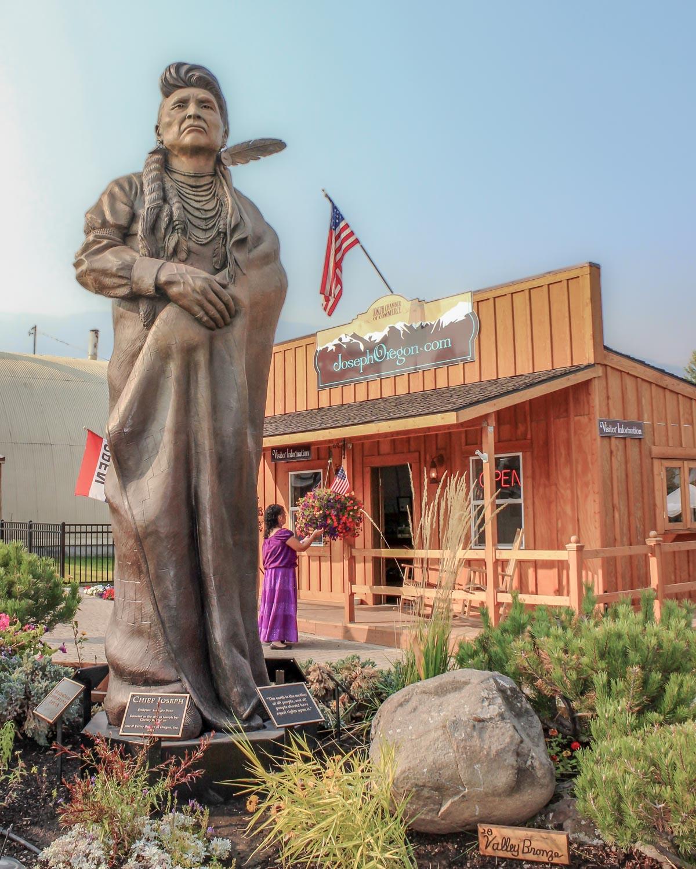 Joseph, Oregon visitor center and Joseph bronze sculpture - Photo by Ron Huckins