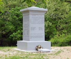 Monument to the Eight Witnesses near the graves of Christian and Peter Whitmer in Richmond, MO .
