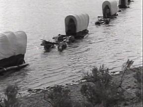 Wagons crossing river.jpg