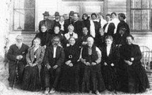 William 5th from left on top row, Henrietta is 3rd from the right on the front row Photo of old Wellington settlers.