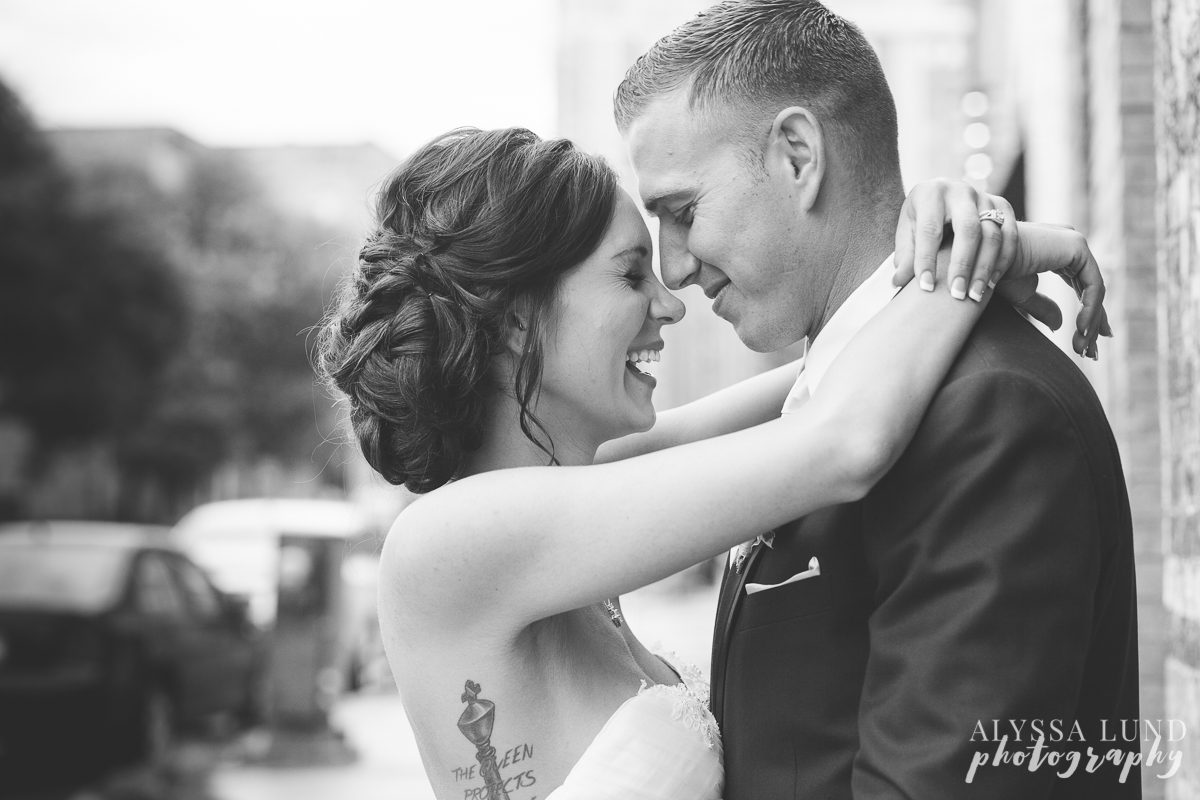 Laughing wedding portrait outside Aria Minneapolis
