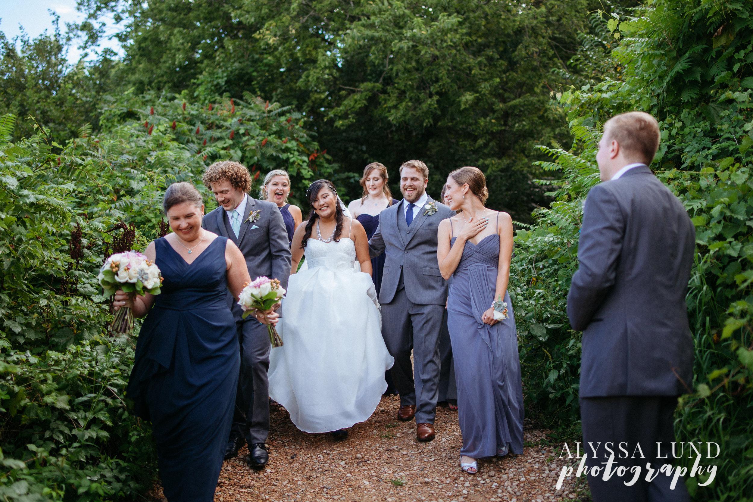 Outdoor Minnesota Wedding Walking with Wedding Party