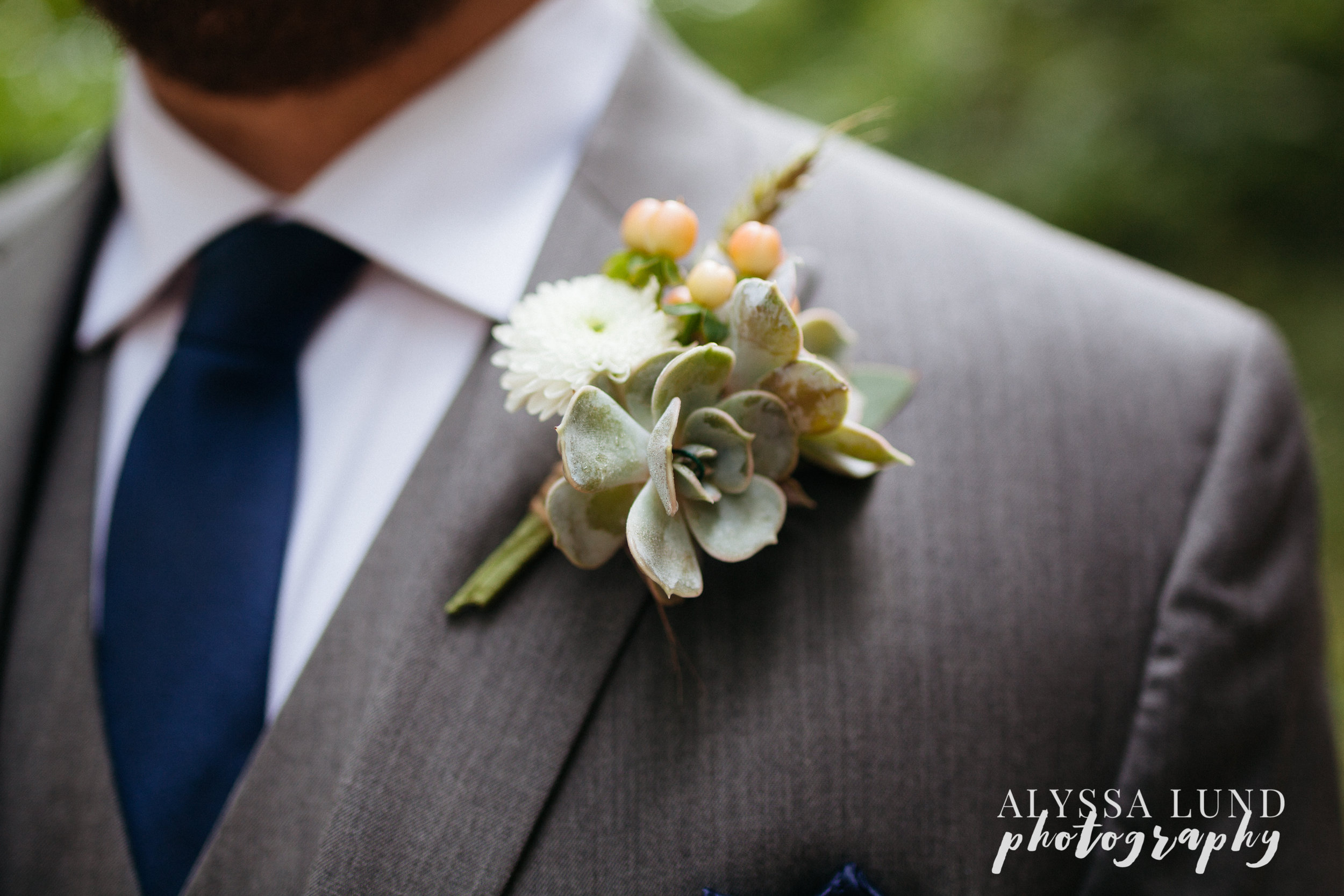 Wedding boutonniere with succulents