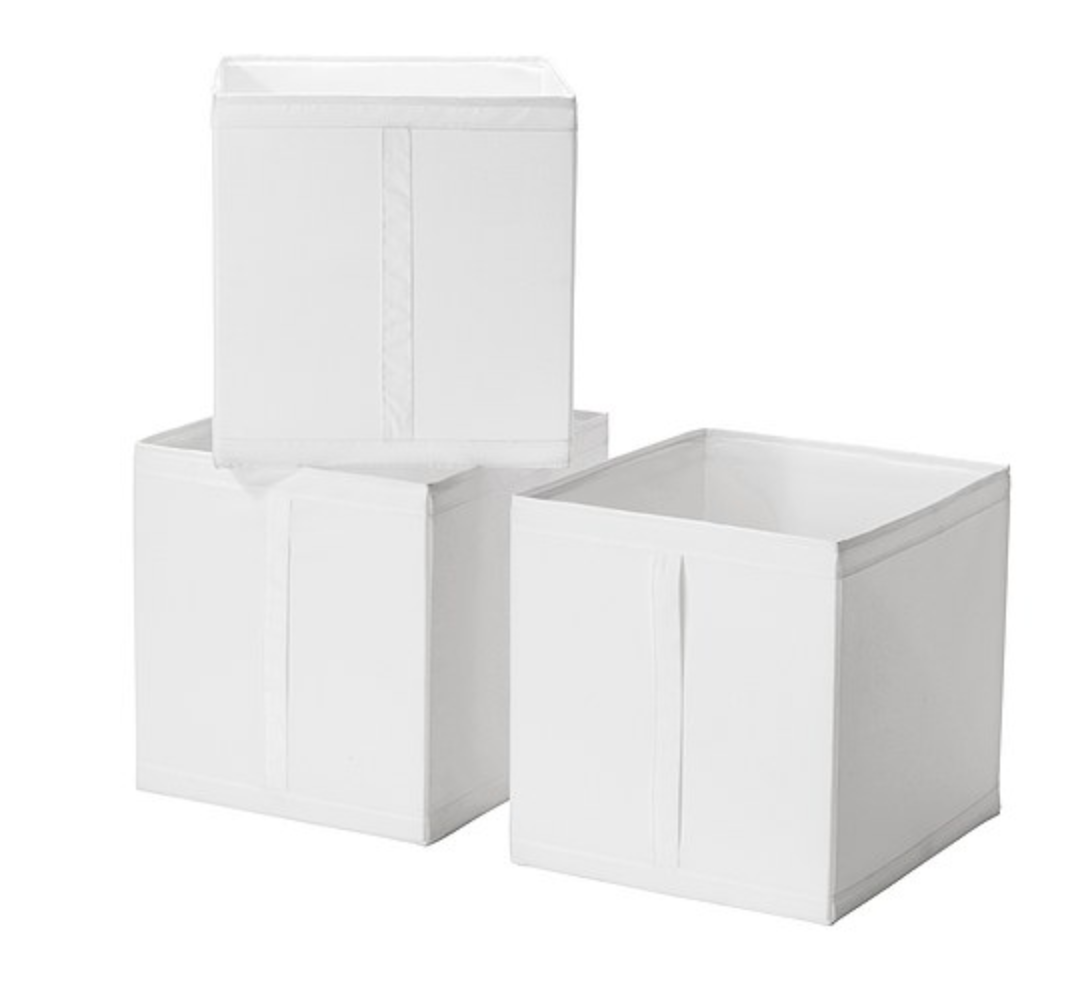 These are collaspable clothes or storage containers that fit inside your drawers. Perfect for socks and pesky things.