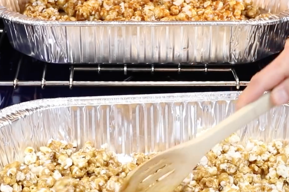 6. Bake the caramel popcorn. Bake for one hour, stirring every 15 minutes and breaking up any clumps. -