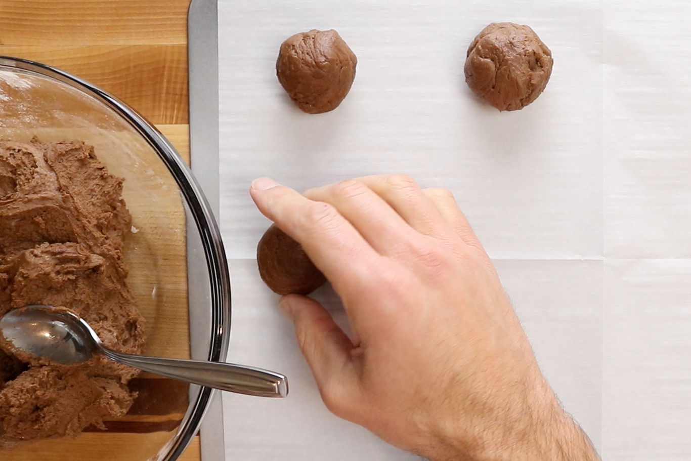 5. Drop teaspoon sized balls of dough on a parchment lined baking sheet. -