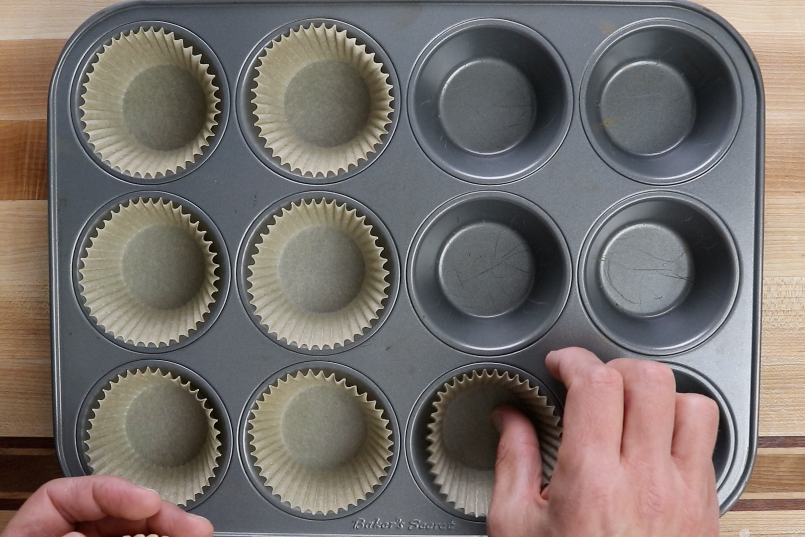 1. Preheat oven to 400 degrees F and prepare 12 muffin cups with paper liners. -