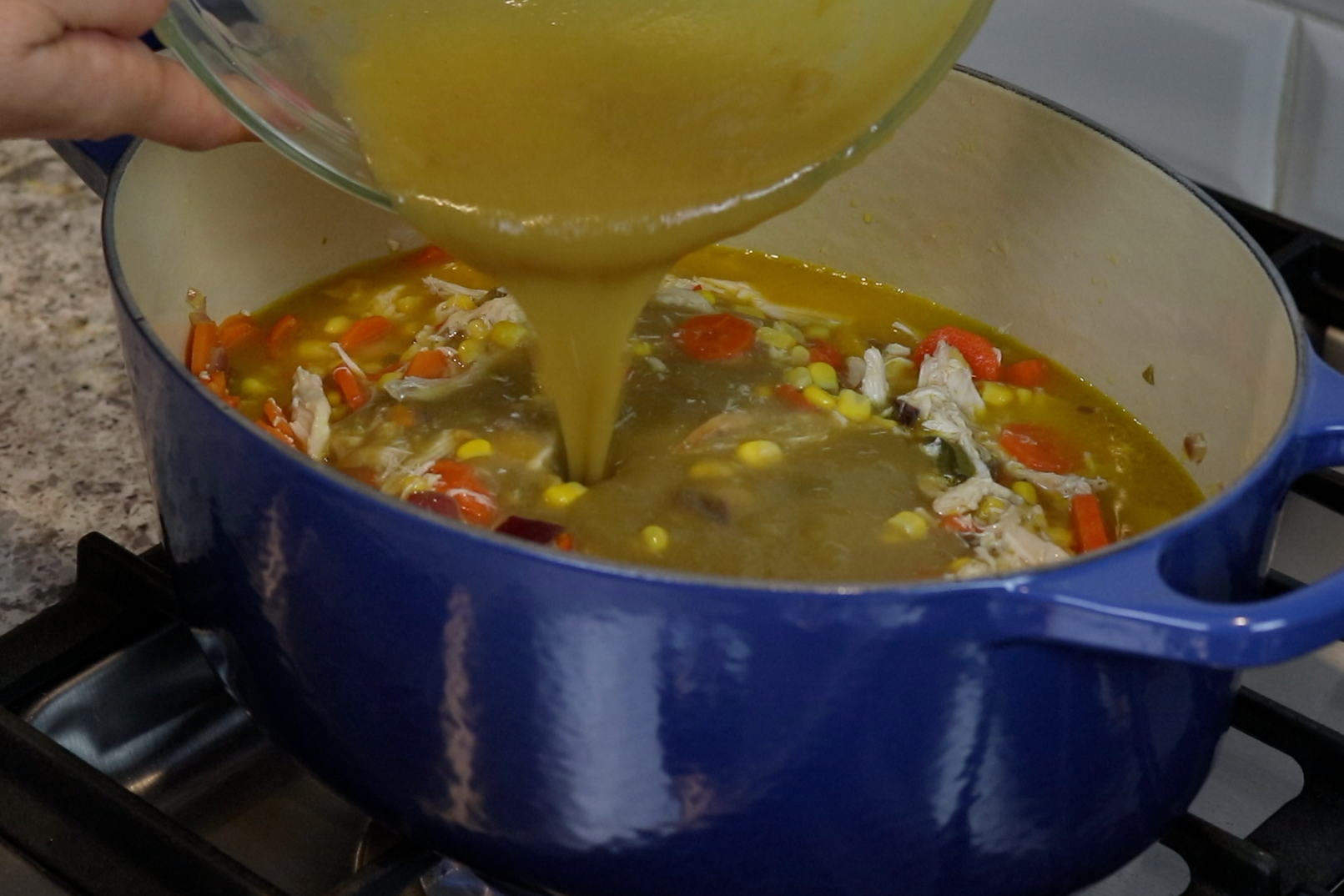 6. Add the corn, broth and enchilada sauce and mix together. -