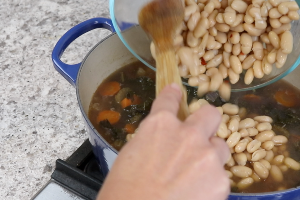 7. Drain the beans, rinse with cold running water and drain again. Cover and put them in the refrigerator. Discard the bay leaves and add the beans. Add 1 cup of water. Increase to medium and bring to a light boil. -