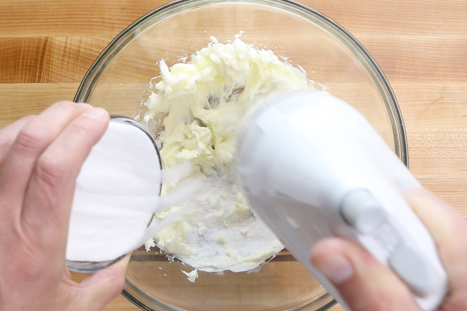 1. In a large mixing bowl, use a hand mixer to cream the butter and sugar together. Beat in vanilla. -