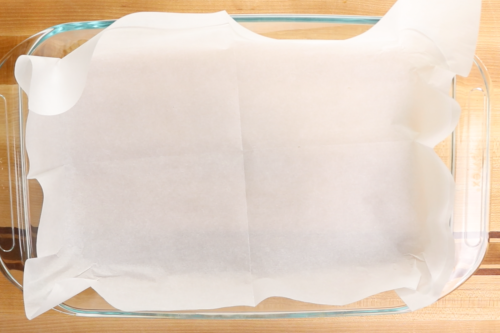 1. Preheat oven to 350 degrees. Line a 9x13 inch pan with parchment paper. -