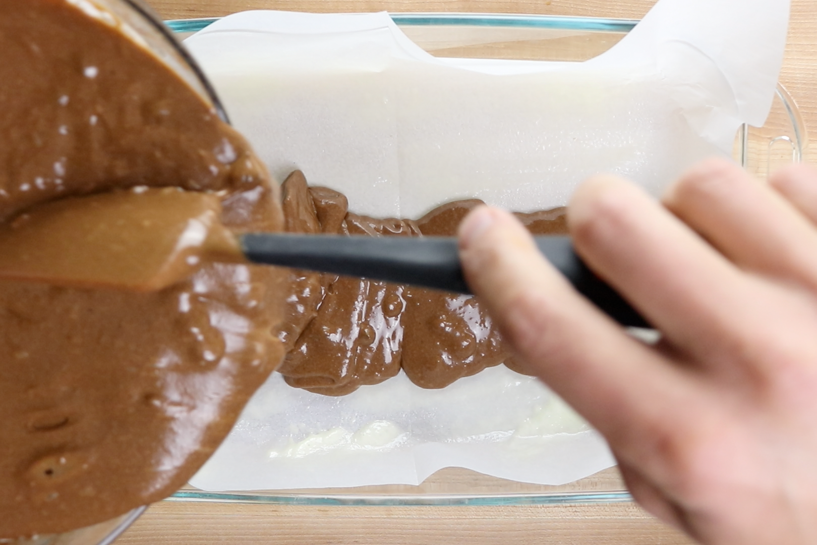 6. Spoon two thirds of the batter into the greased 9x13 inch pan. Bake for 12 minutes.  -