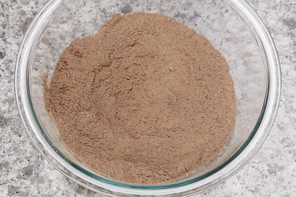 2. In a large bowl, combine the spelt flour, cocoa powder, baking soda and salt then stir together.  -