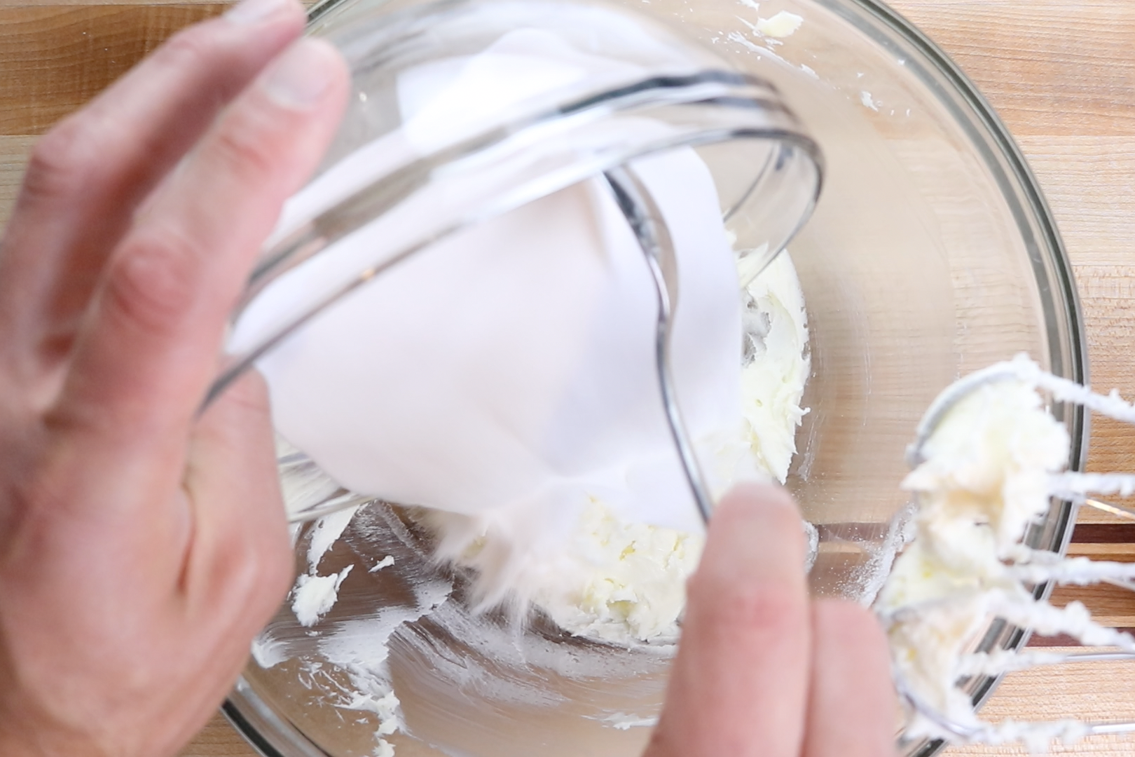 2. Slowly add sugar and mix over medium-low speed until incorporated. -