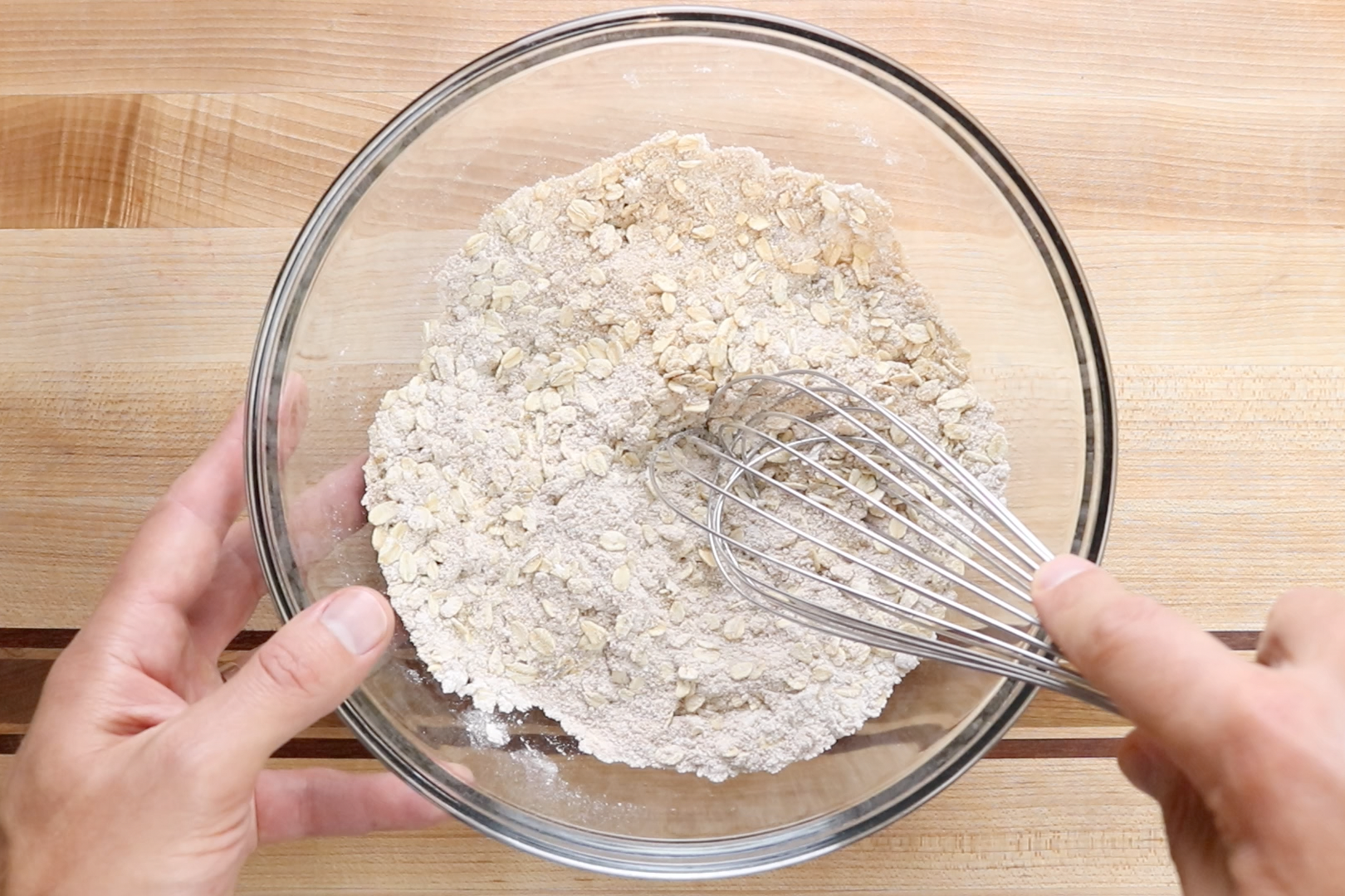 3. In another bowl, whisk together the flour, oats, brown sugar, cinnamon, salt, baking powder, and baking soda. -
