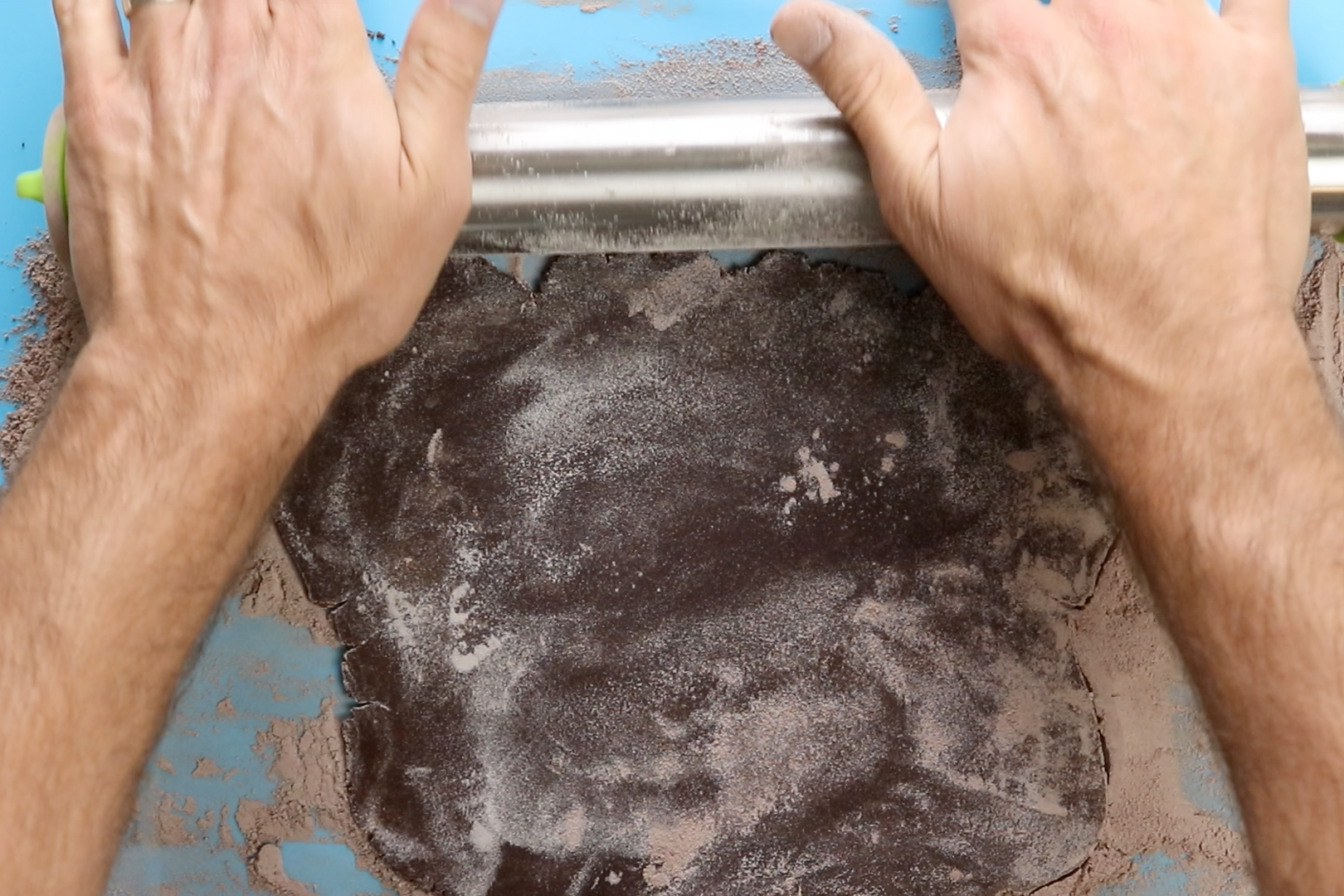 7. Roll out the dough until ¼-inch thick using an equal mix of flour and cocoa powder to keep from sticking. -