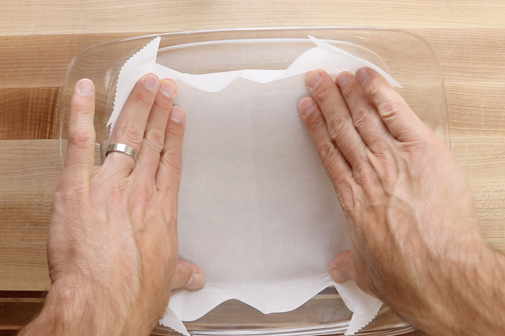 1. Preheat oven to 350 degrees. Line an 8x8-inch baking dish with parchment paper. -