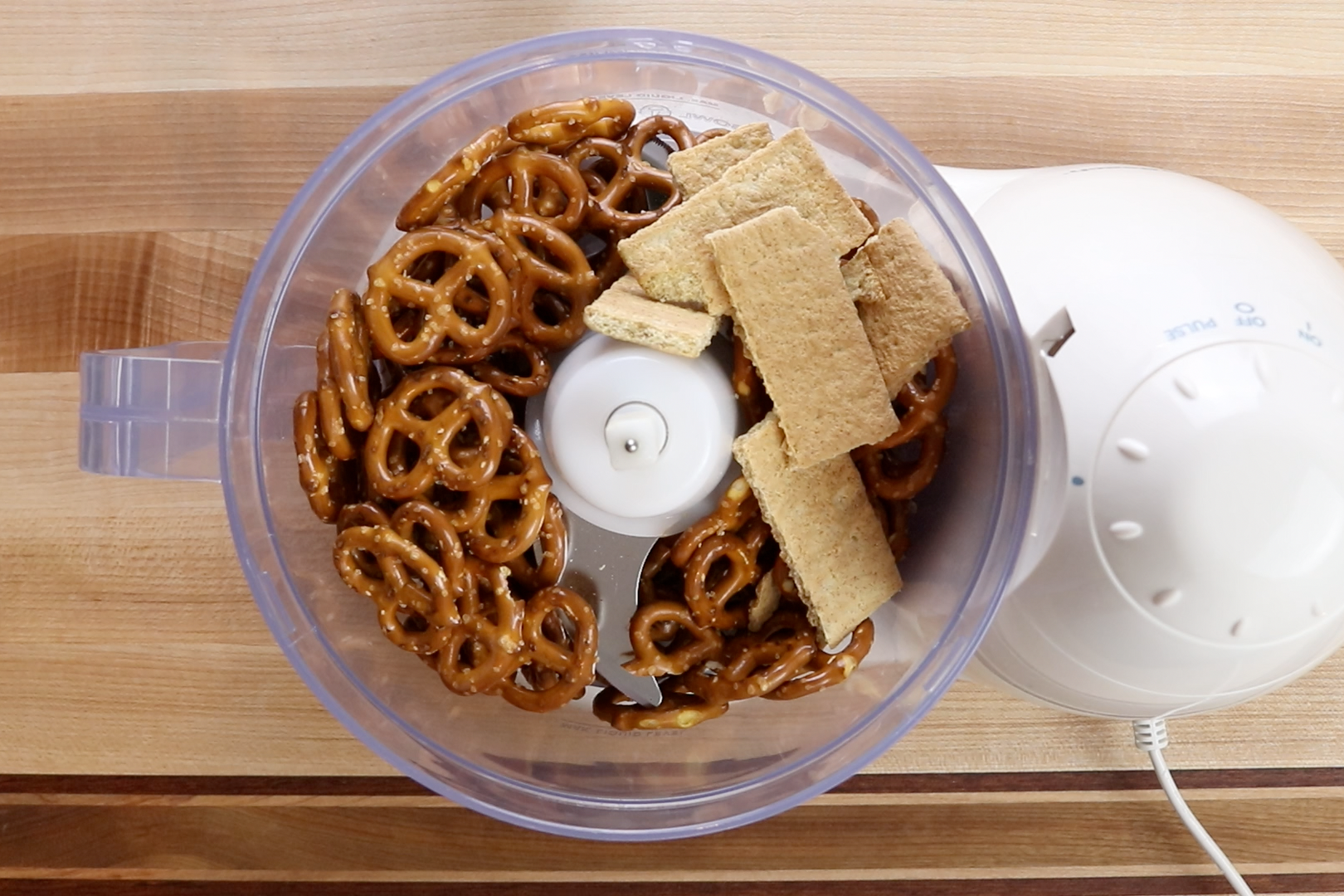 2. In a food processor crush the pretzels and the graham crackers. -