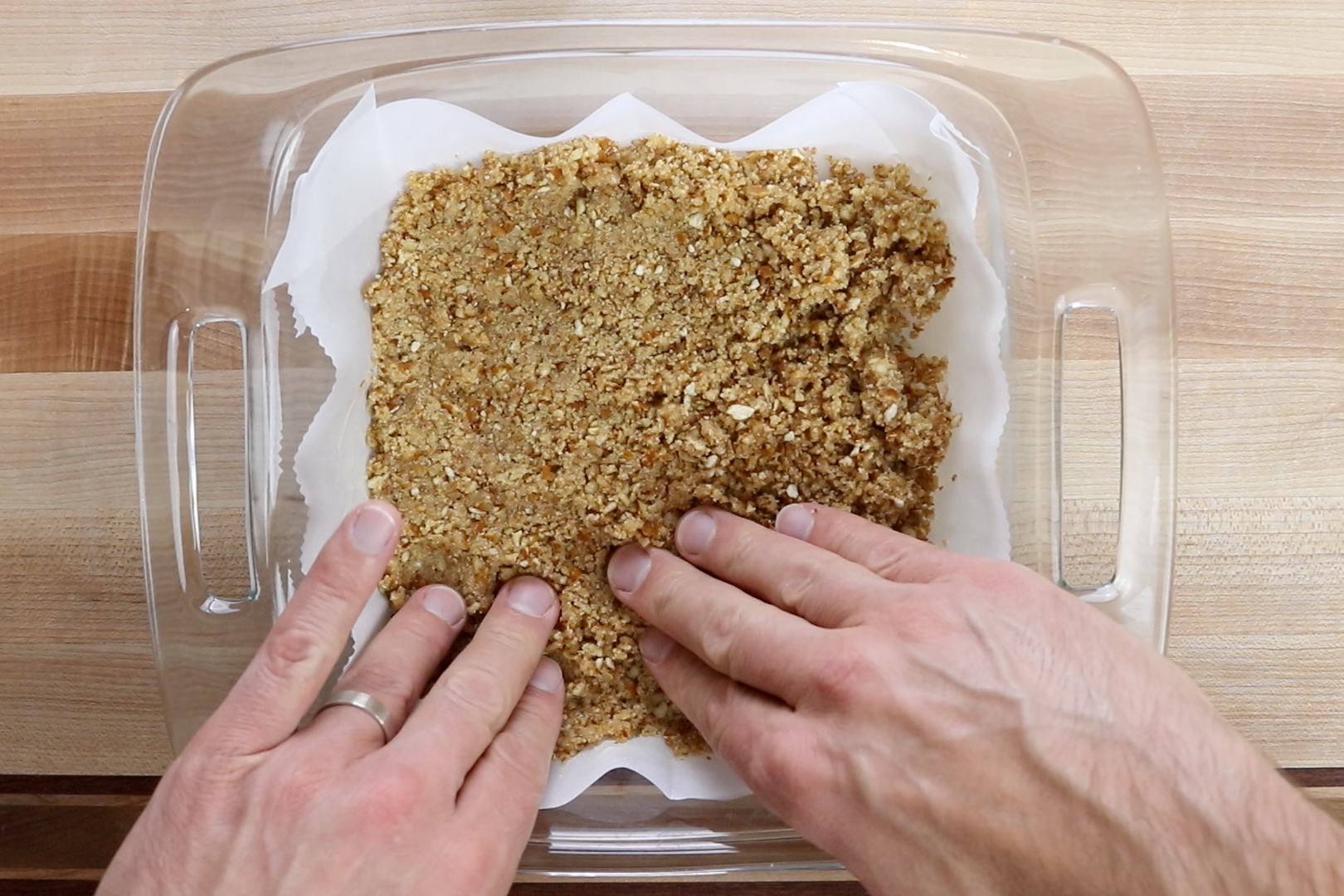 5. Put the mixture in the prepared baking dish and gently press down with your fingers. -