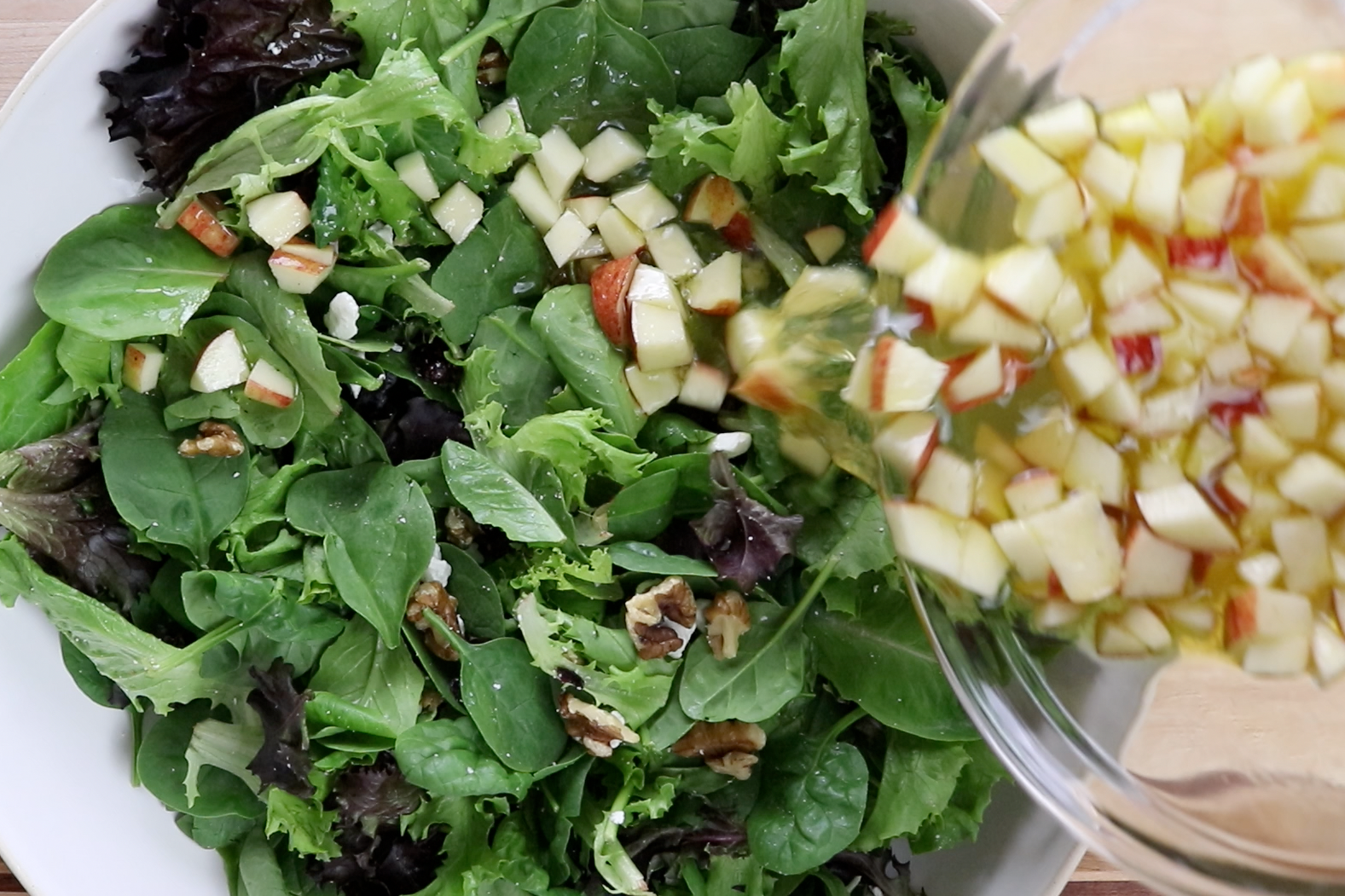 5. Pour apple dressing over salad and toss together. -