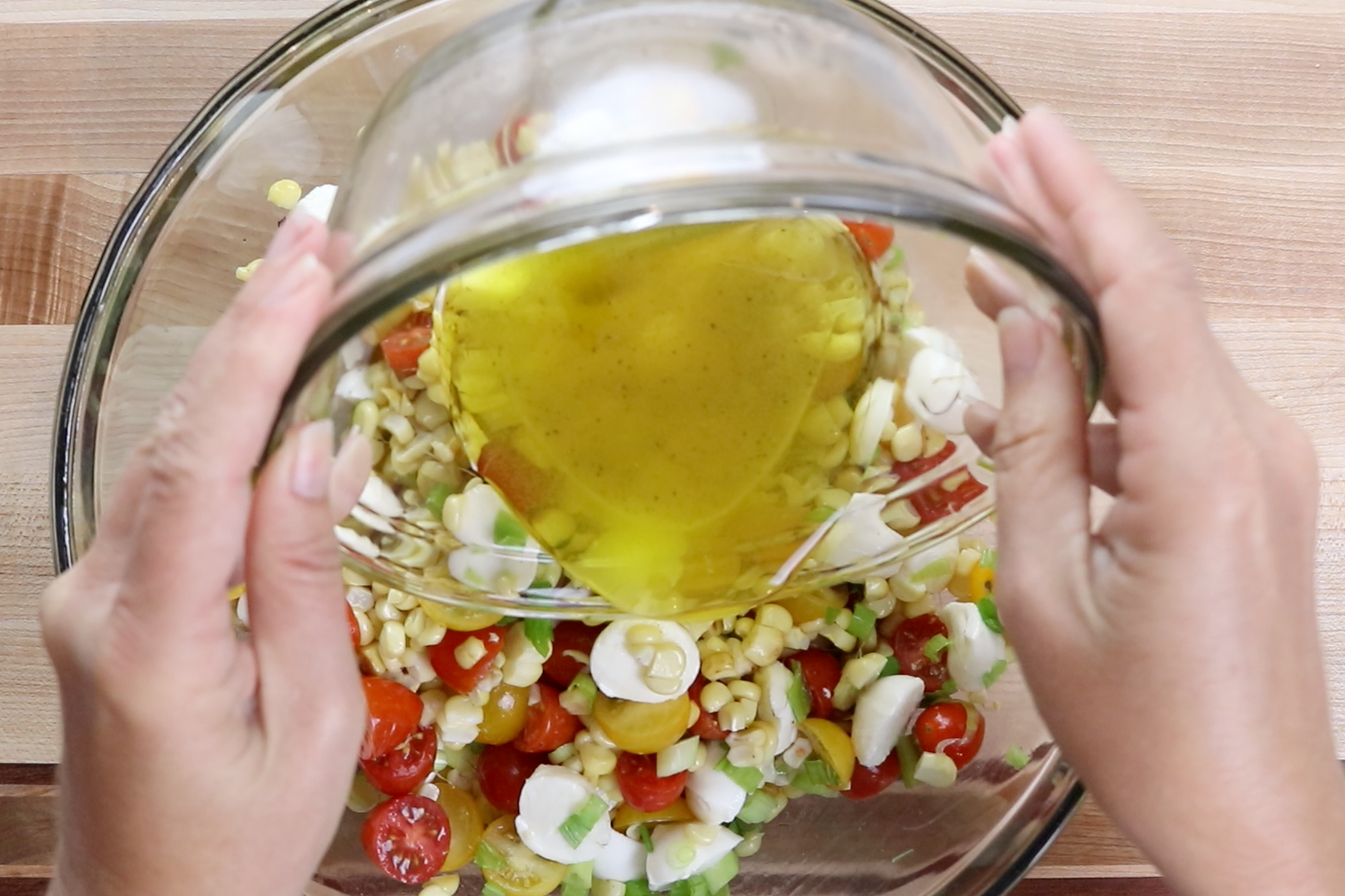 7. Pour the dressing over the salad and gently toss. -