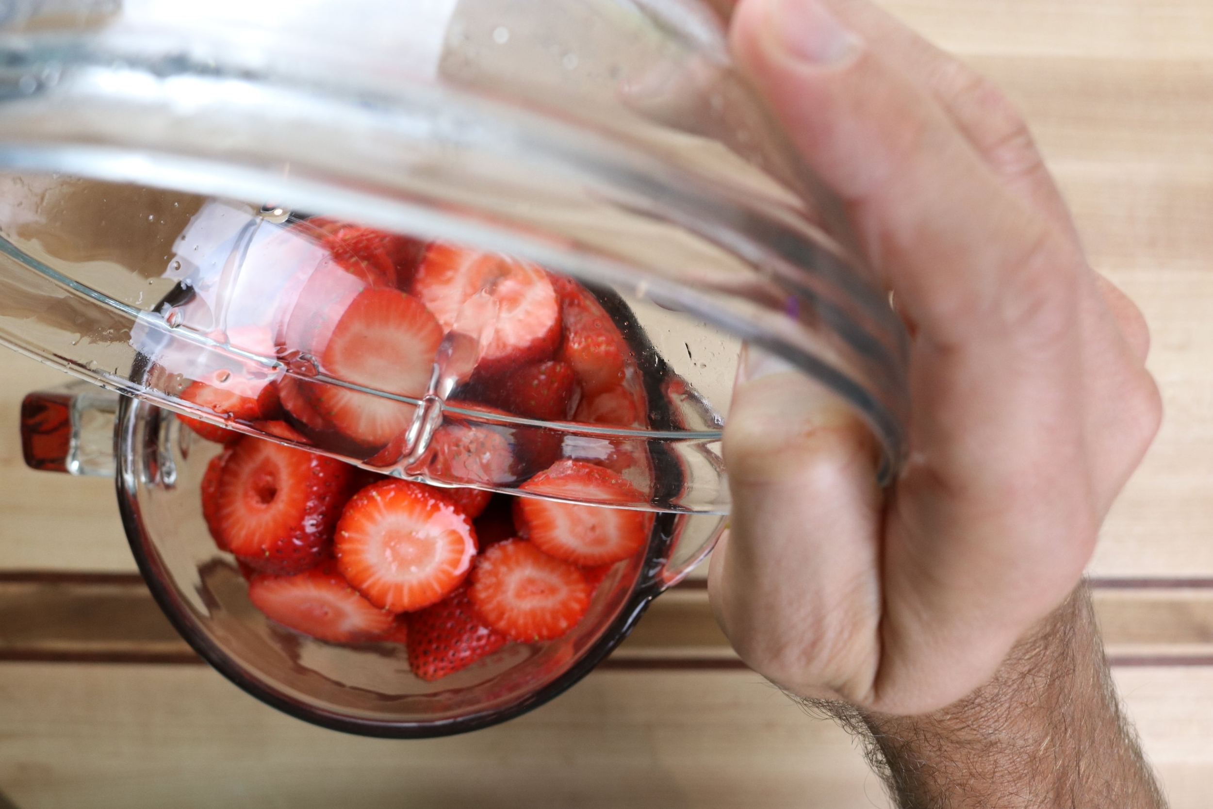 6. Place the stem-less strawberries and citrus juice in a blender and purée. -