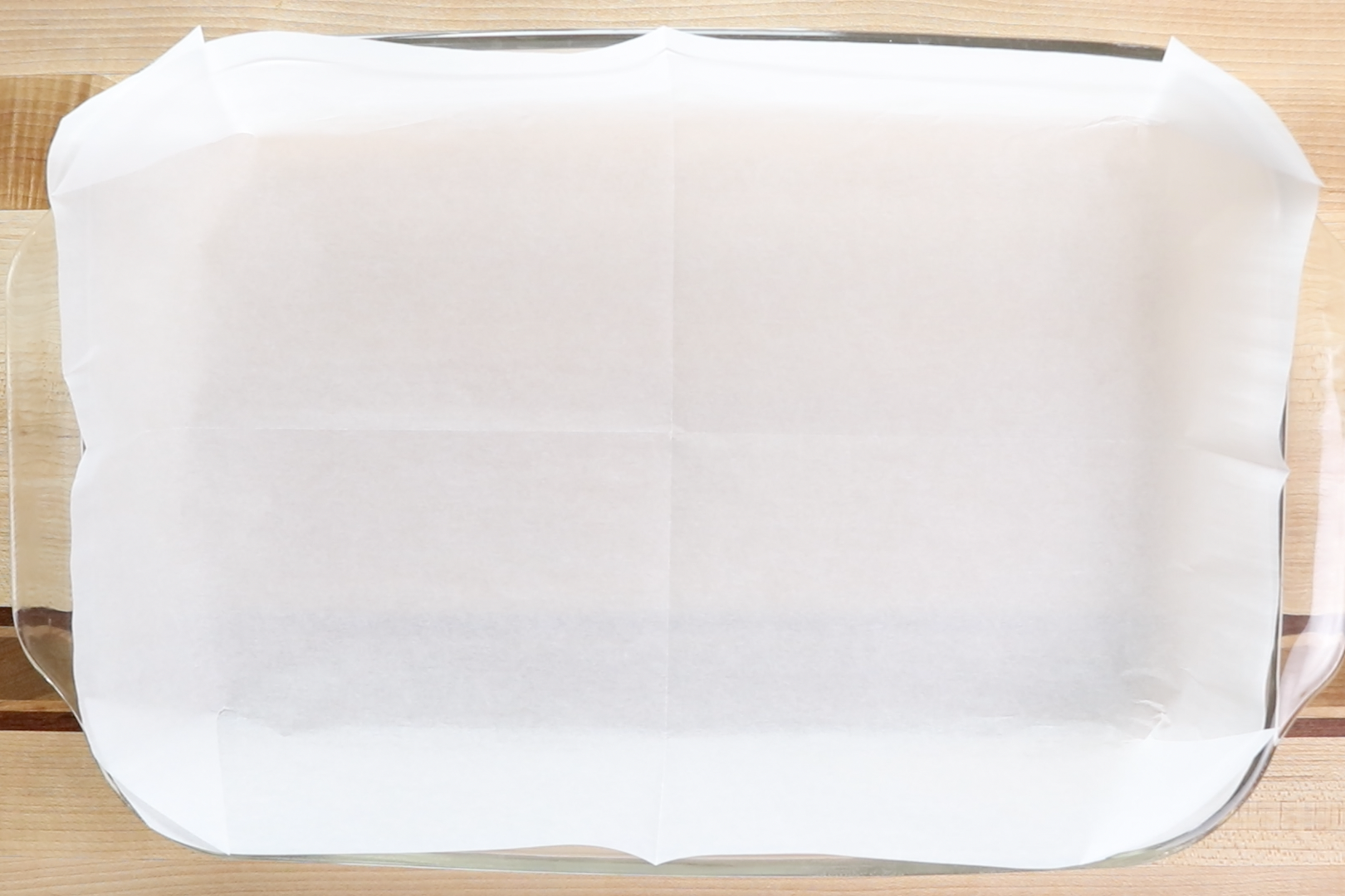 1. Preheat oven to 350 degrees. Prepare a 9x13-inch baking pan with parchment paper. -