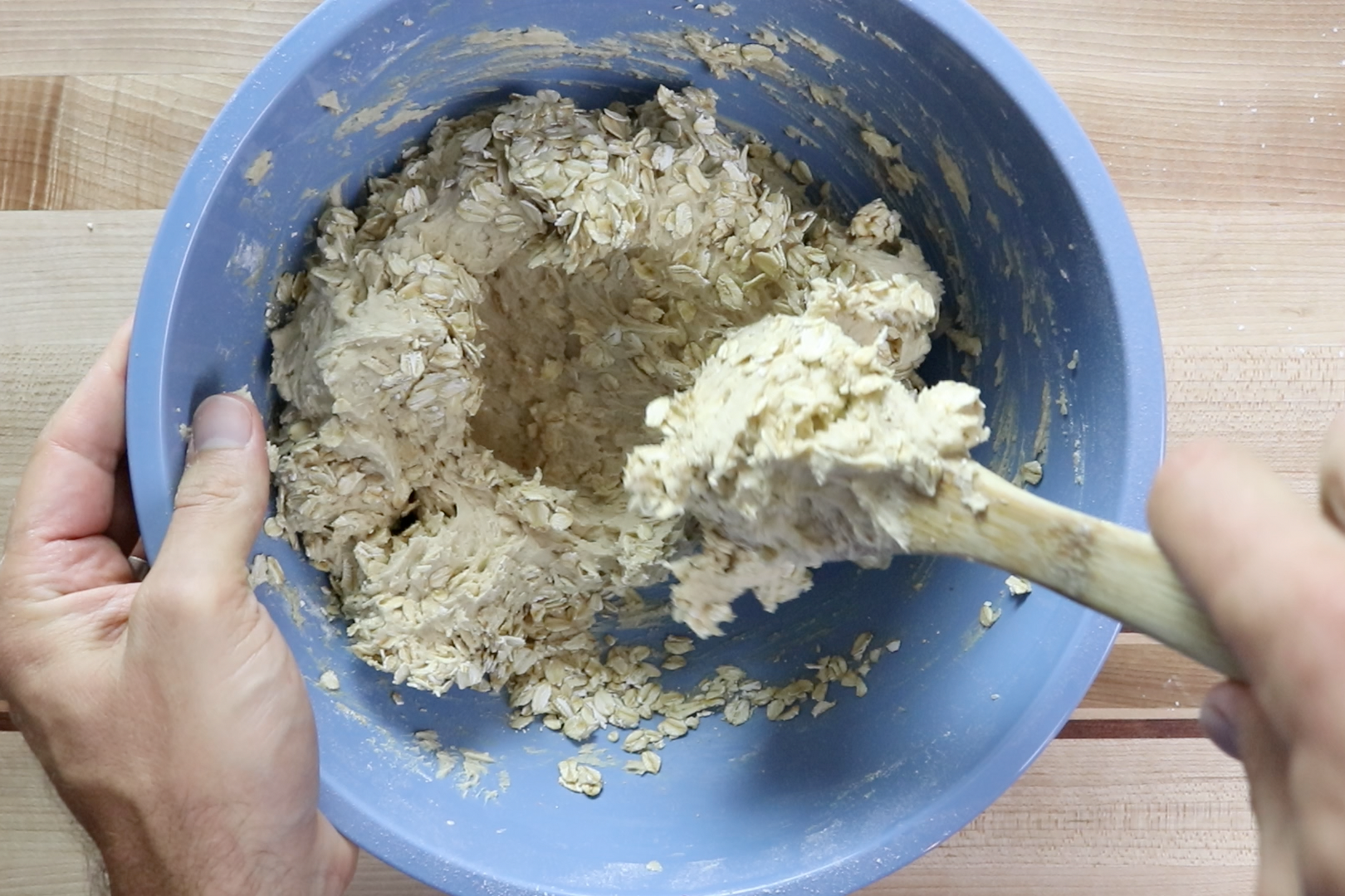 6. Add the rolled oats and mix by hand. -