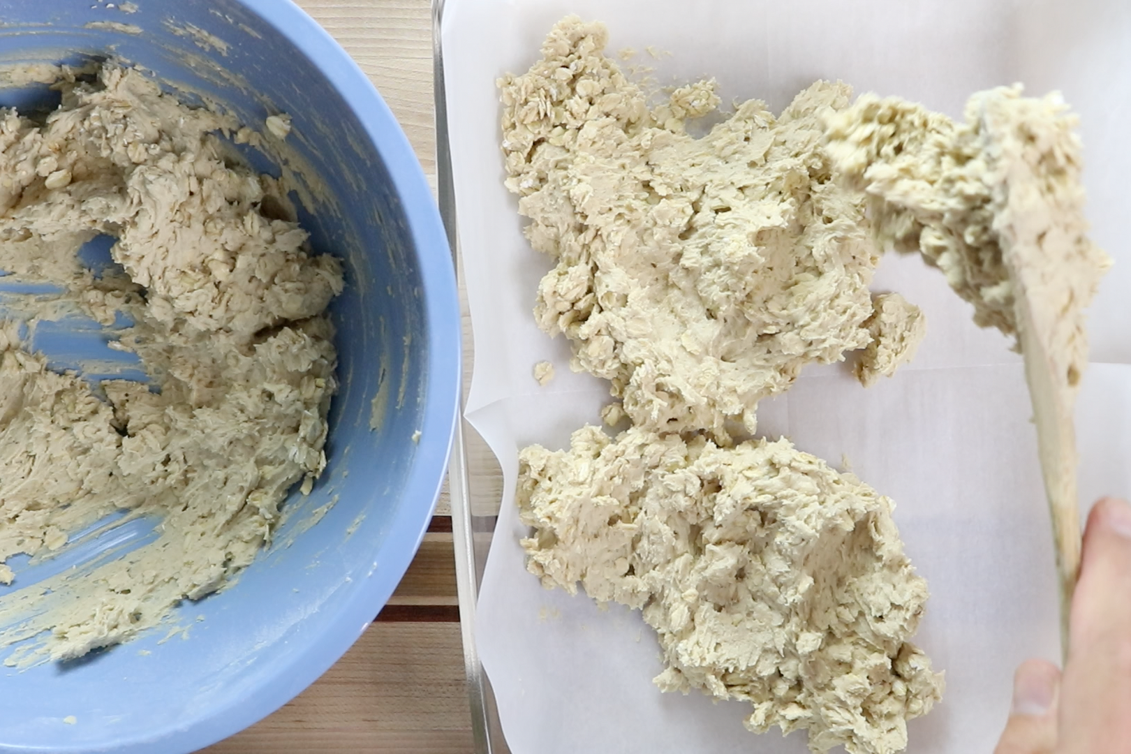 7. Spread ½ of the mixture into the prepared baking pan. It will be sticky. -