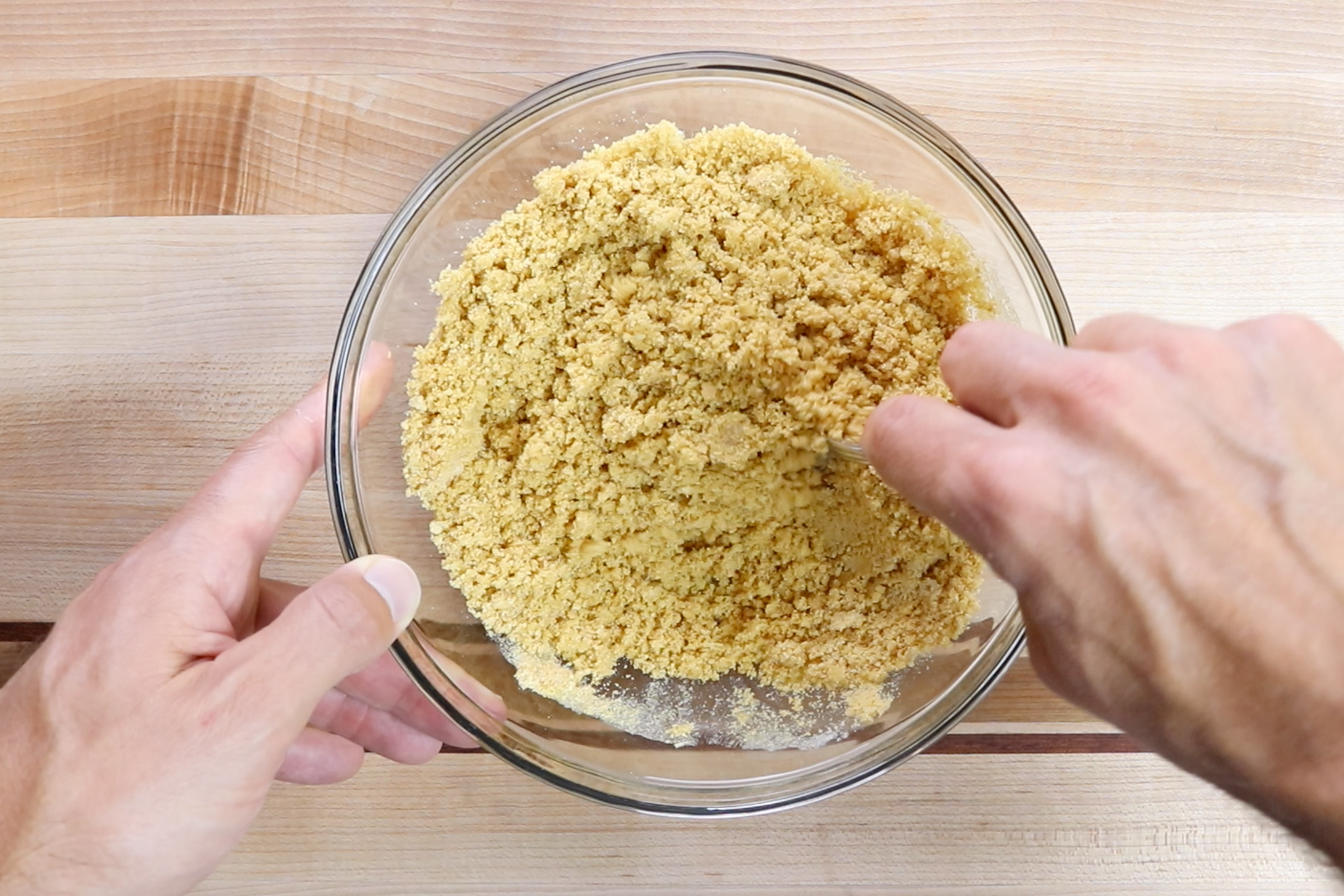 2. Using a food processor or a rolling bin with a Ziploc bag crush the graham crackers into crumbs. Pour into a medium bowl. Add the melted butter and sugar. Mix until combined and has the consistency of wet sand. -