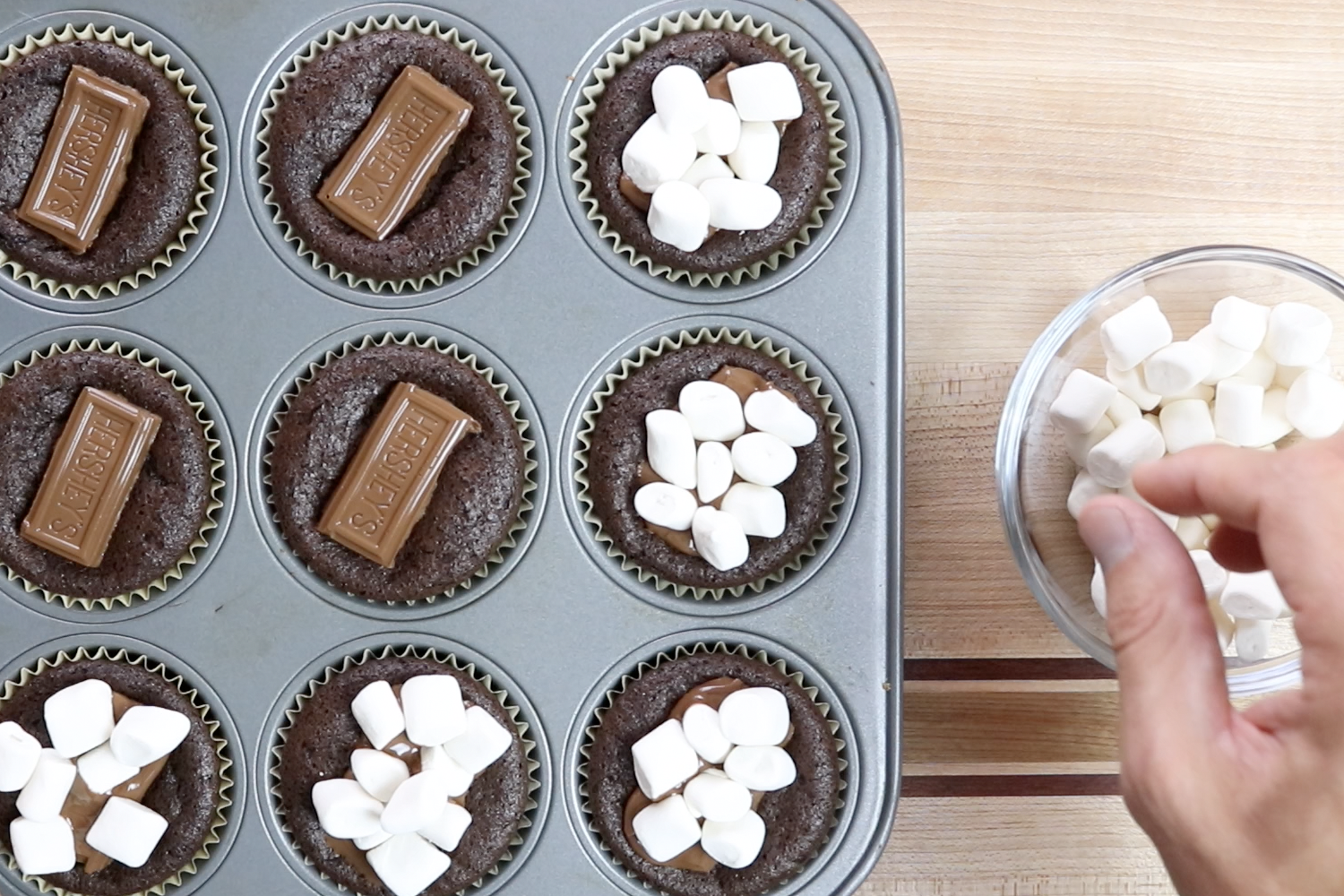 12. Remove from oven. While chocolate is gooey add a few marshmallows on top of each brownie cup. -