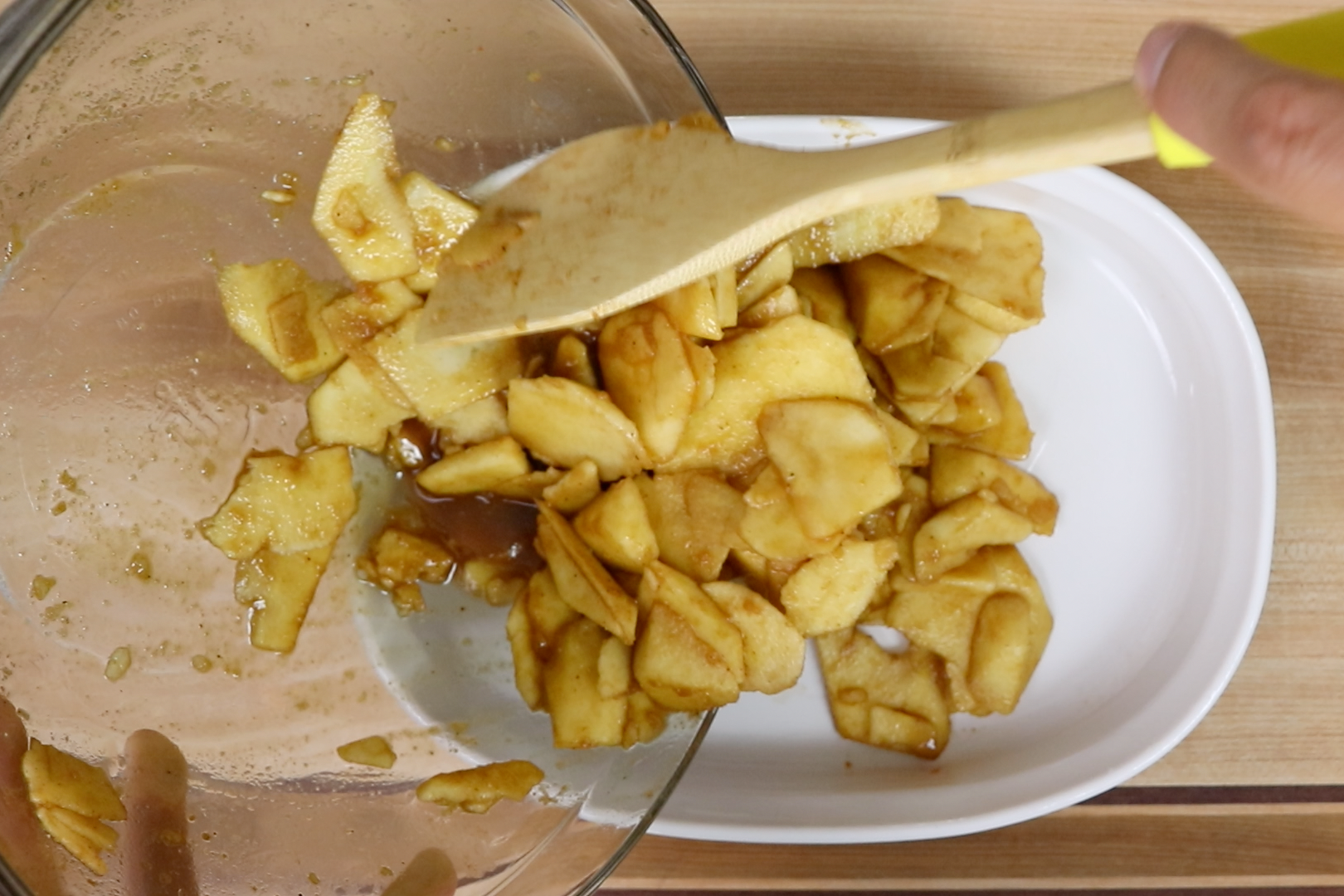 5. Pour apple mixture into the prepared baking pan. Use the spatula to smooth apples into an even layer. -