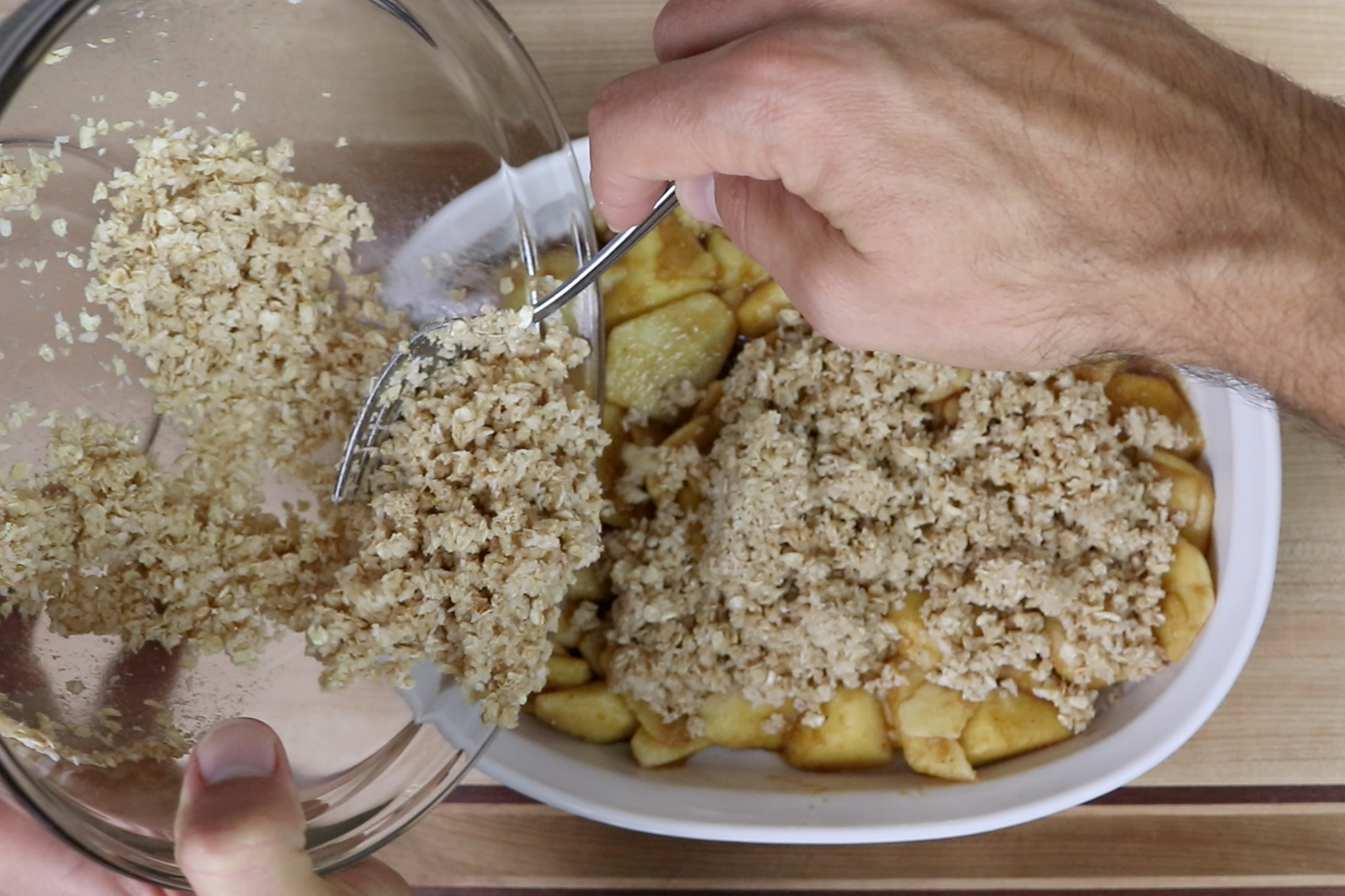 6. Gently spoon topping over apples and spread until apples are covered. -