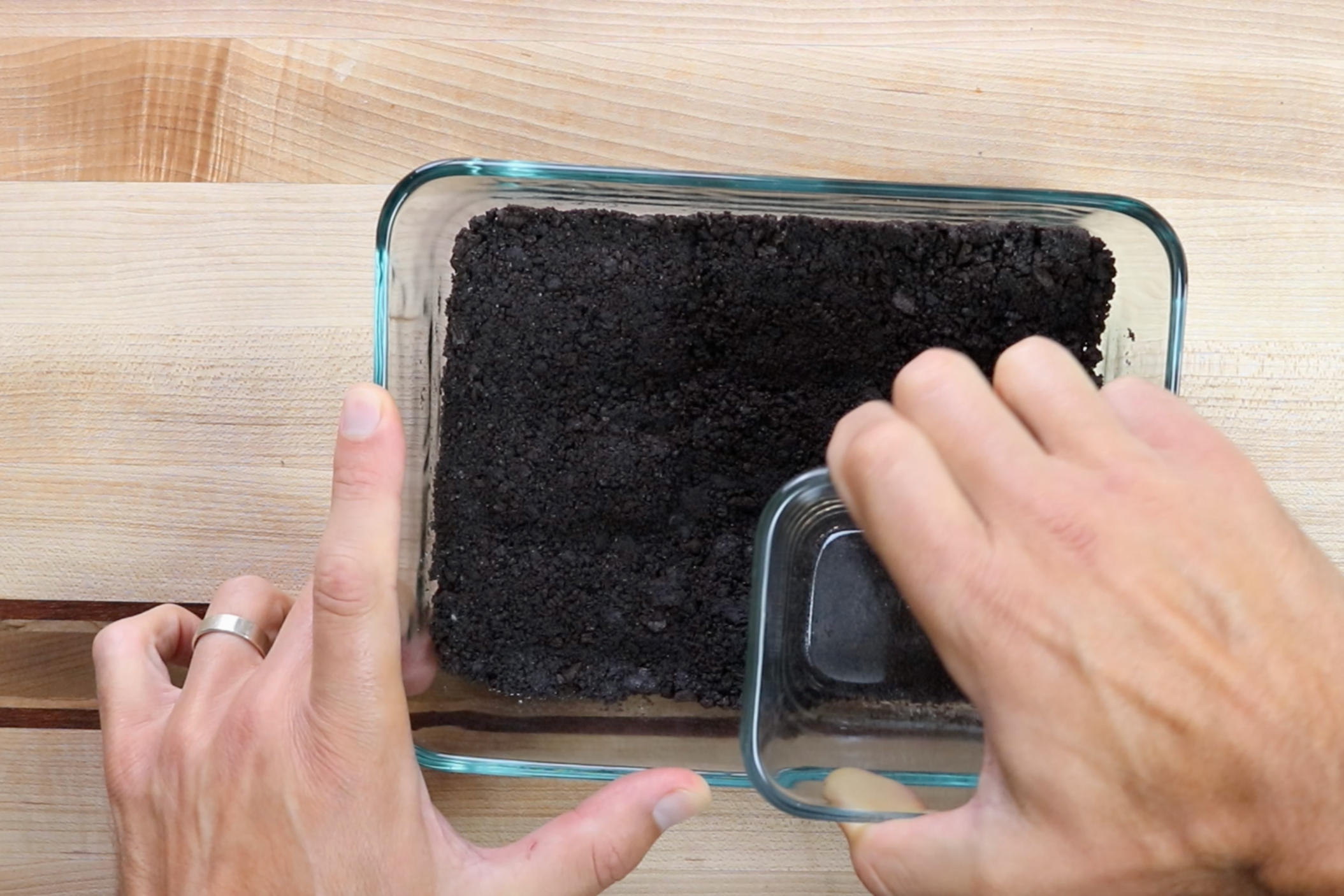 4. Place 1/2 of the Oreo mixture in the bottom of the 6 cup rectangular glass dish and press down in a compacted layer. -